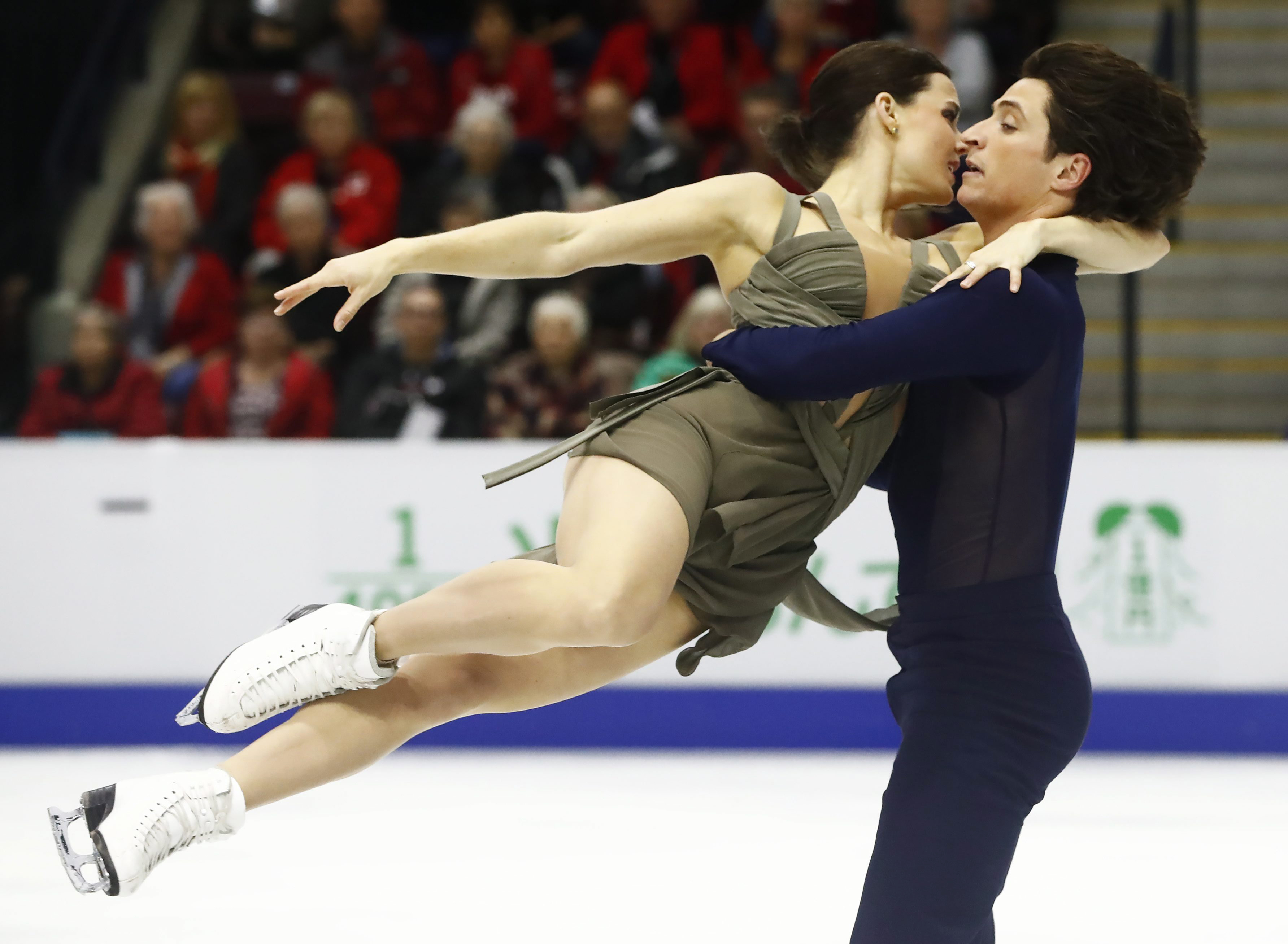 FILE - In this Oct. 29, 2016, file photo, Canada's Tessa Virtue and Scott Moir perform in the ice dance free skate during the Skate Canada figure skating event in Mississauga, Ontario, Canada. Virtue and Moir will compete in the Rostelecom Cup in Moscow t