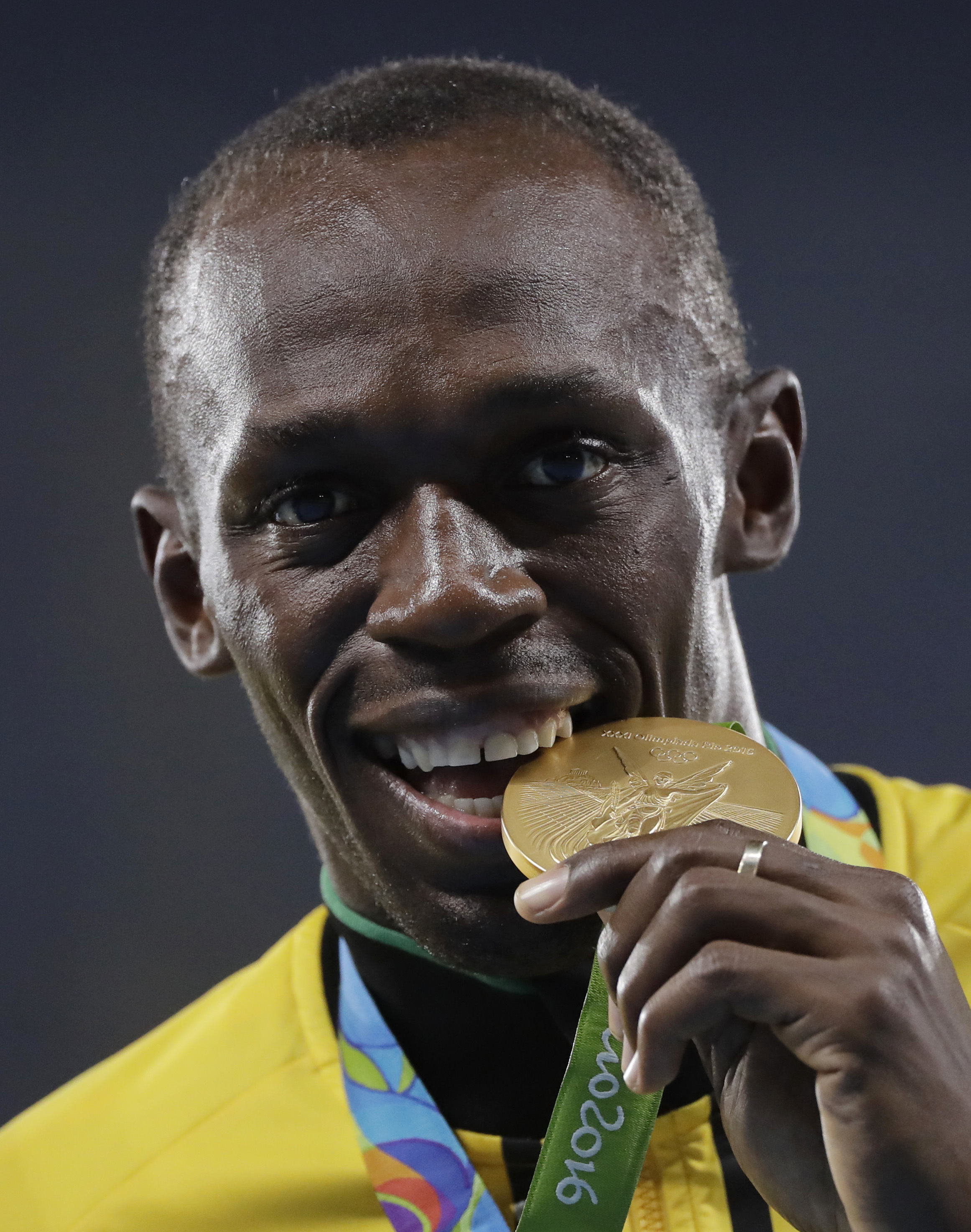 FILE - In this Aug. 20, 2016 file photo Jamaica's Usain Bolt poses with his gold medal for the men's 4x100 meters relay during an athletics podium ceremony at the Summer Olympics at Olympic stadium in Rio de Janeiro, Brazil. Bolt will return to the Golden