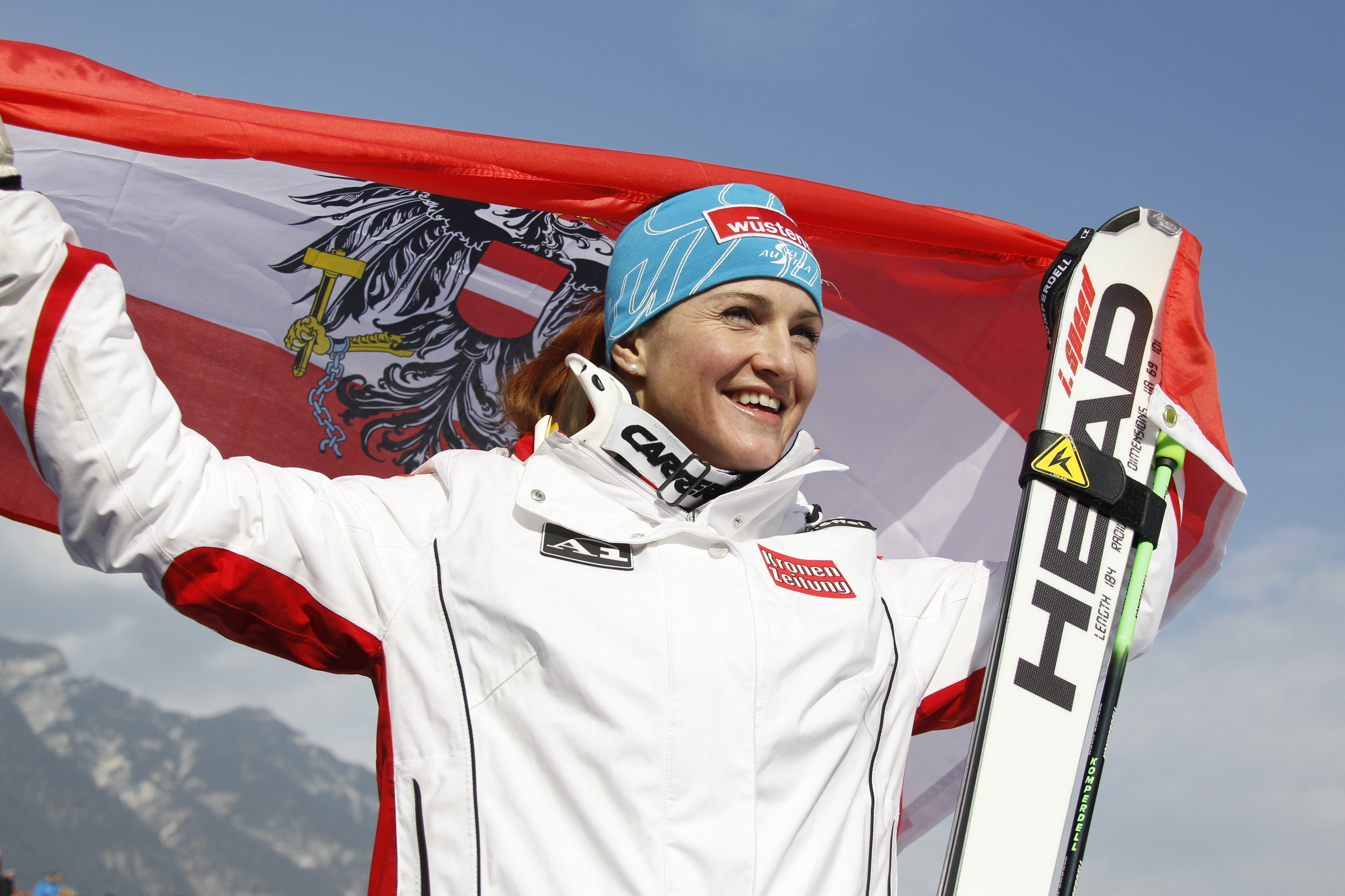 FILE - In this Feb. 13, 2011 file photo Austria's Elisabeth Goergl celebrates with a national flag after winning the women's downhill, at the Alpine World Skiing Championships in Garmisch-Partenkirchen, Germany. Goergl is retiring, 2 years after becoming
