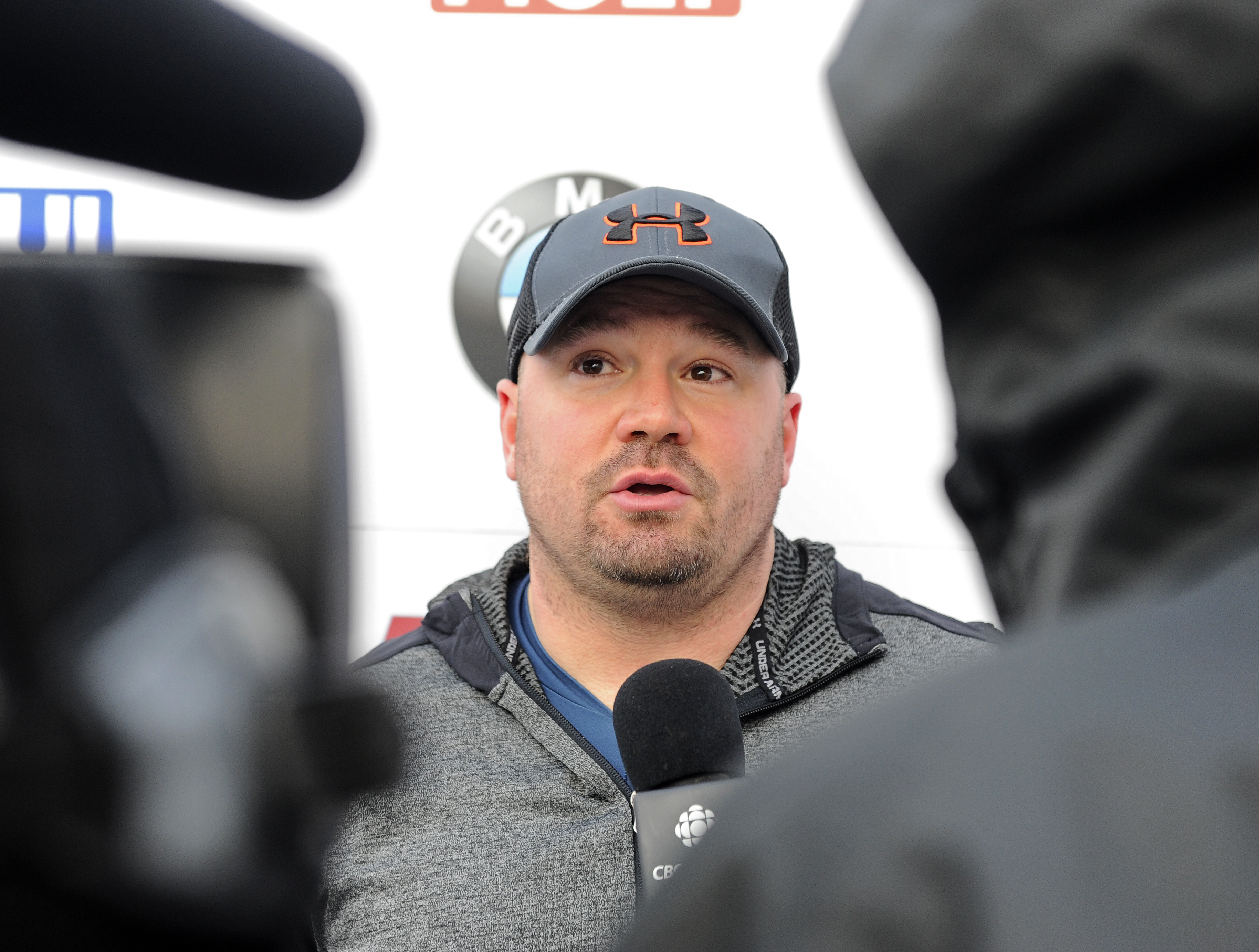 FILE - In this Friday, Dec. 16, 2016 file photo, driver Steven Holcomb, of the United States, talks with reporters in the finish area after winning the mens two-man bobsled World Cup race in Lake Placid, N.Y. Olympic bobsledding champion Steven Holcomb ha