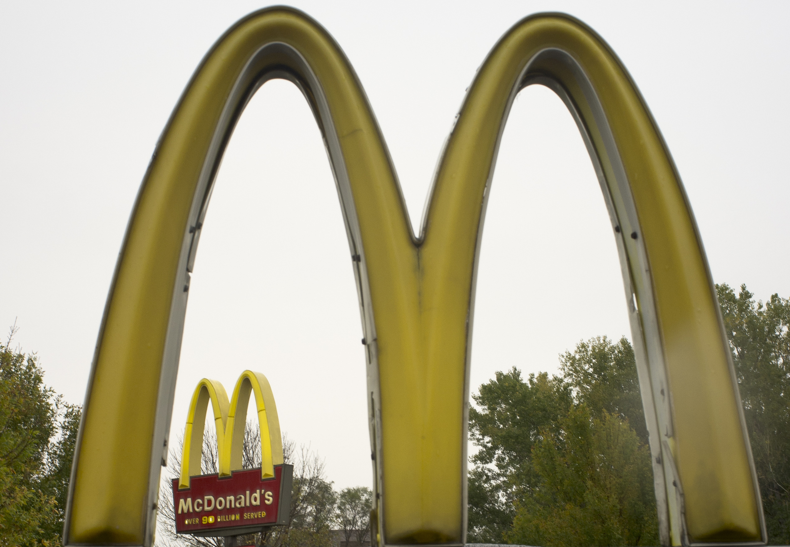 FILE - This Oct. 21, 2011 file photo shows the golden arches of McDonalds, in Omaha, Neb.,  McDonald's has ended its Olympic sponsorship deal three years early. The International Olympic Committee says confidential financial terms of the immediate separat