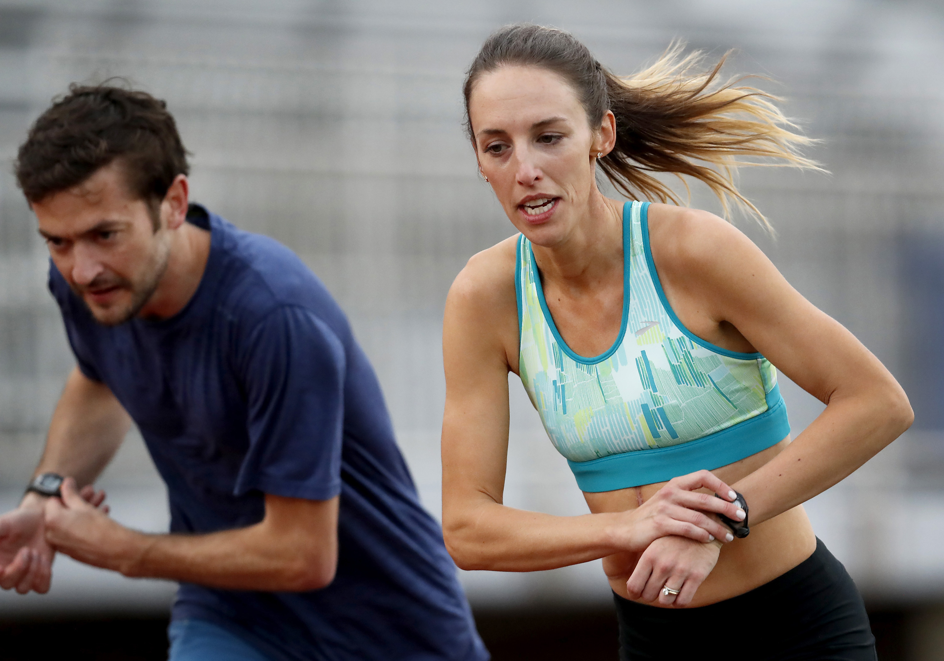 FILE - In this May 8, 2017, file photo, Gabriele Grunewald trains at Macalester College in St. Paul, Minn. Grunewald is two weeks into chemotherapy to treat cancer that's gone from her salivary gland to her liver. That won't keep her from taking the start