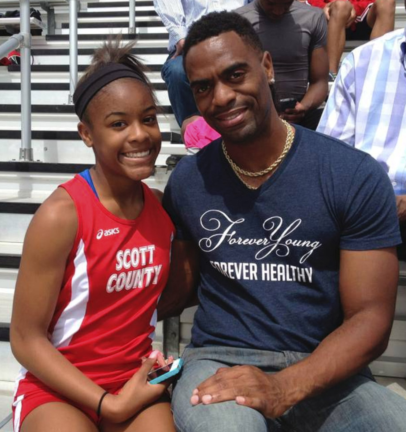 FILE - In this May 3, 2014, file photo, Trinity Gay, a seventh-grader racing for her Scott County High School team, poses for a photo with her father, Tyson Gay, after she won the 100 meters and was part of the winning 4-by-100 and 4-by-200 relays at the