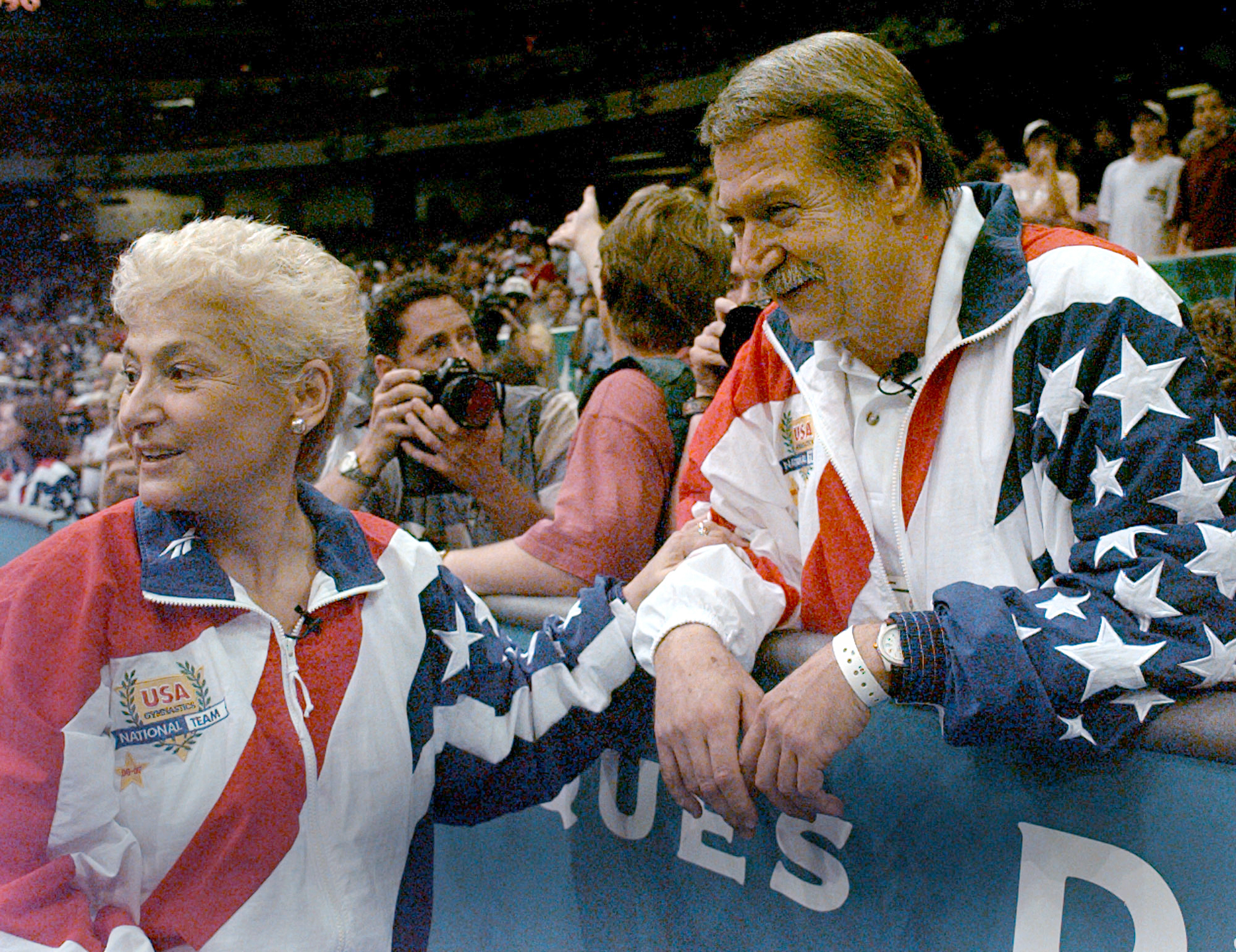 FILE - In this July 23, 2004, file photo, Martha and Bela Karolyi watch together as the U.S. women's gymnastic team celebrates winning the gold medal at the Centennial Summer Olympic Games in Atlanta. The latest lawsuit filed Thursday, Oct. 27, 2016, accu