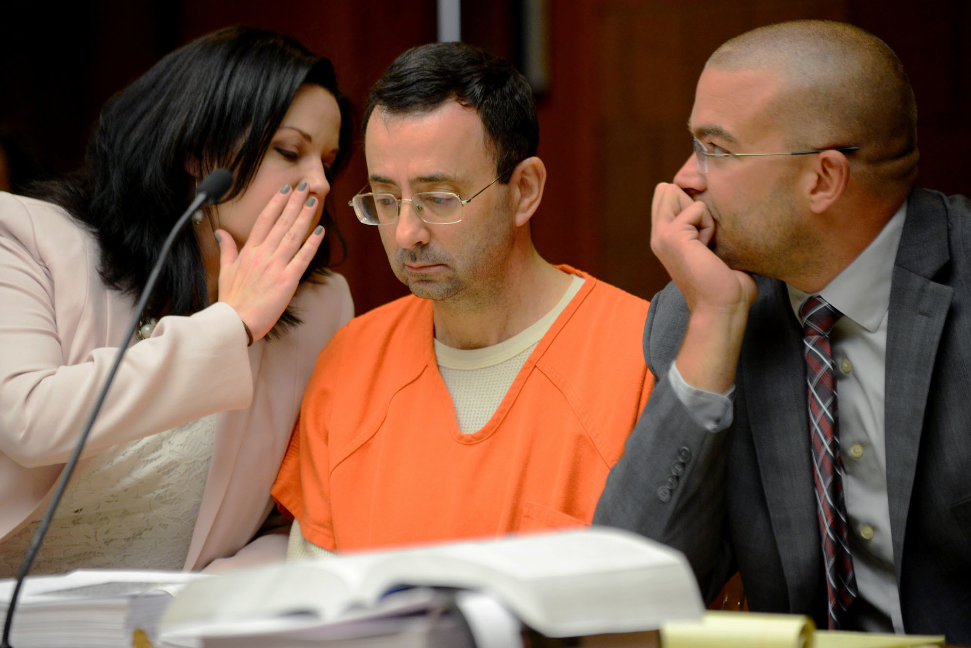 FILE - In this May 26, 2017, file photo, defense attorney Shannon Smith talks to her client, Dr. Larry Nassar, during the second portion of his preliminary hearing on sexual assault at the 55th District Court in Mason,Mich. USA Gymnastics needs to undergo