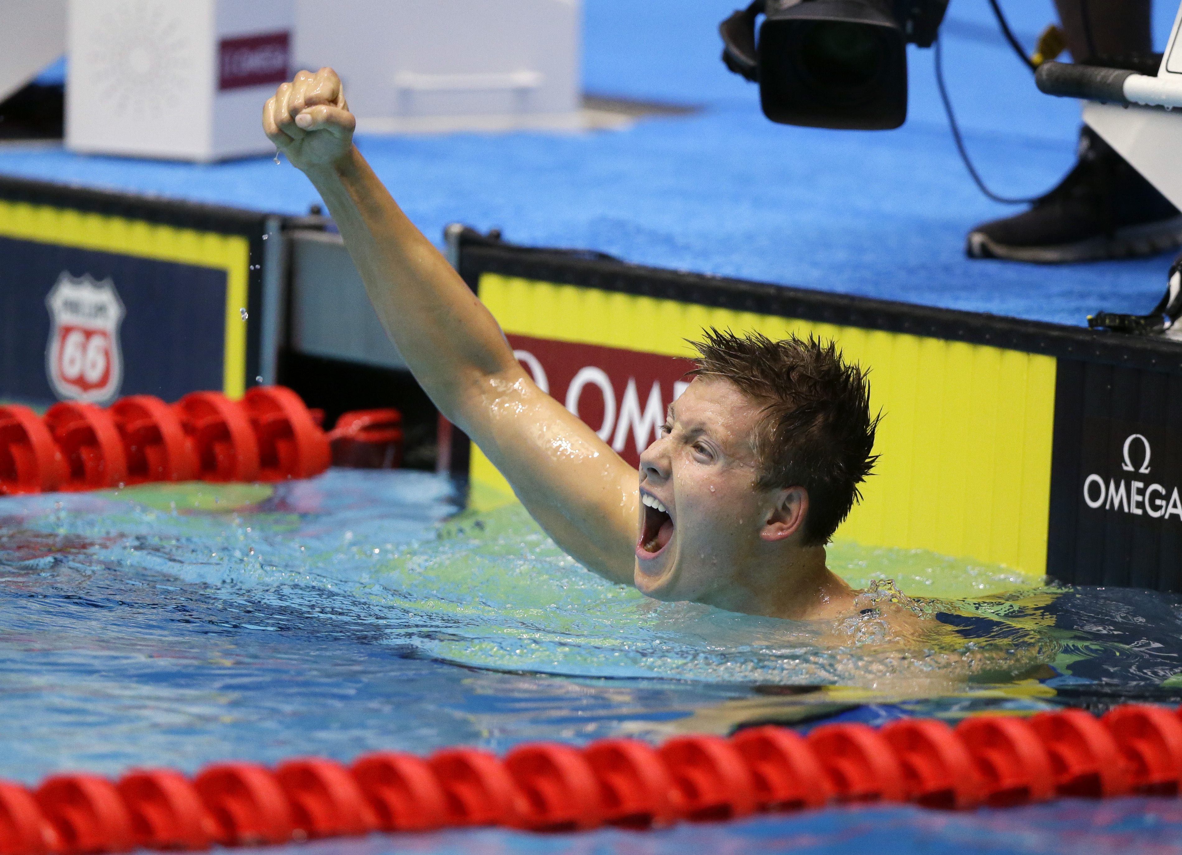True Sweetser celebrates after winning the men's 1,500-meter freestyle at the U.S. swimming championships in Indianapolis, Tuesday, June 27, 2017. (AP Photo/Michael Conroy)