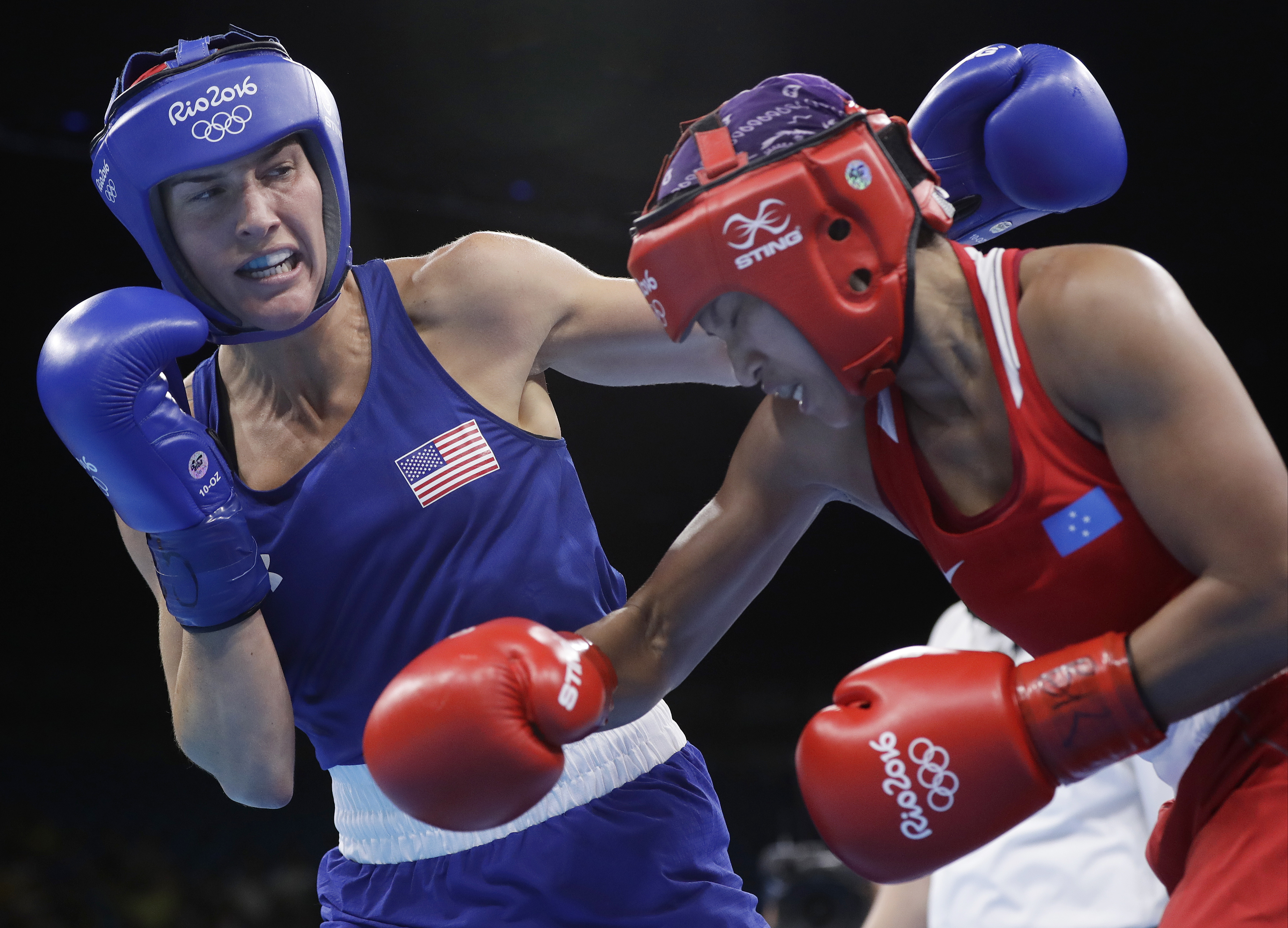 FILE - In this Friday, Aug. 12, 2016 file photo, United States' Mikaela Joslin Mayer, left, fights Micronesia's Jennifer Chieng during a women's lightweight 60-kg preliminary boxing match at the 2016 Summer Olympics in Rio de Janeiro, Brazil. U.S. Olympic
