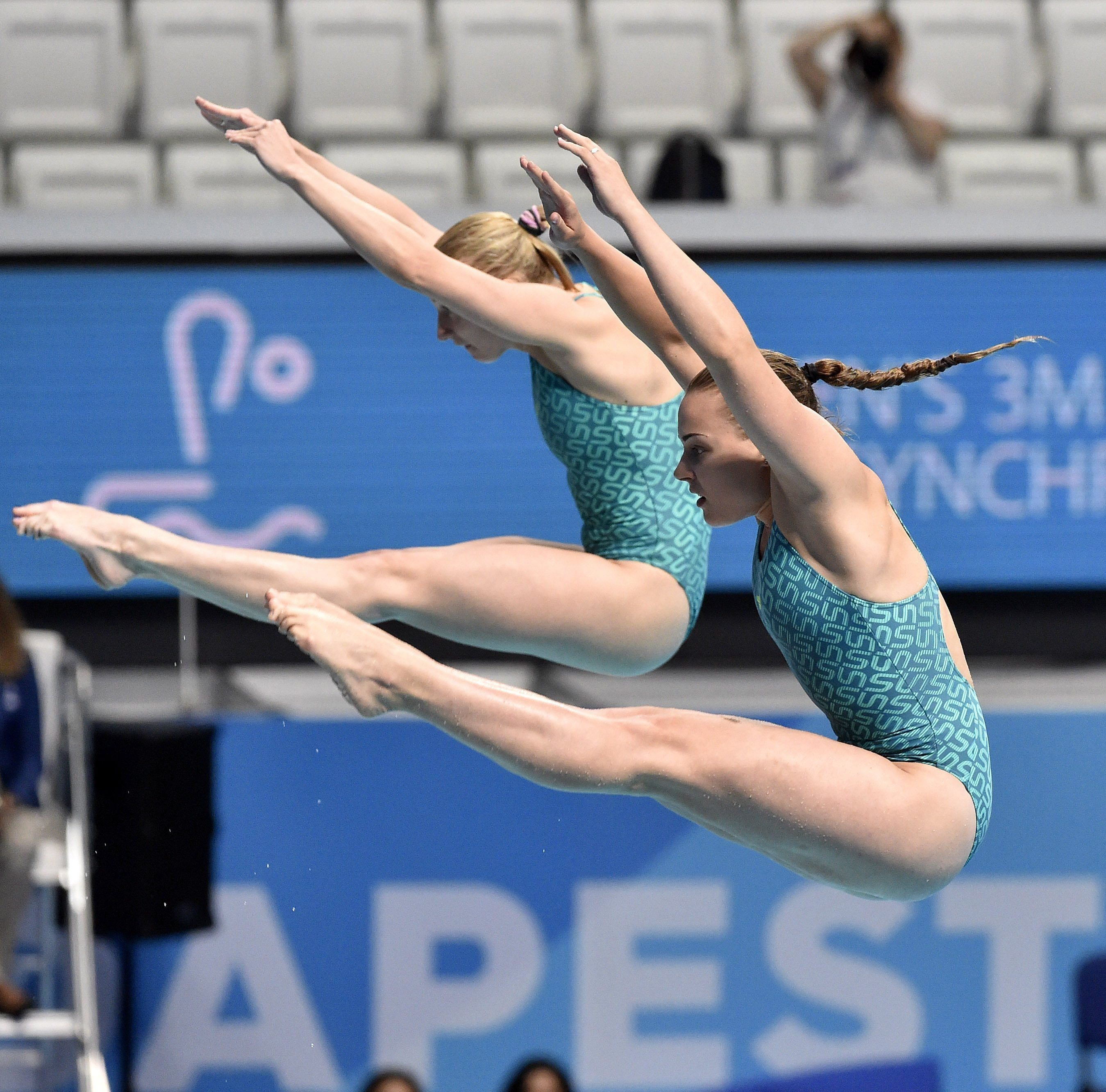 Anastasiia Nedobiga and Diana Shelestyuk of Ukraine compete in the women's 3m synchro springboard final of the 17th FINA Swimming World Championships in Duna Arena in Budapest, Hungary, Monday, July 17, 2017. (Zoltan Mathe/MTI via AP)