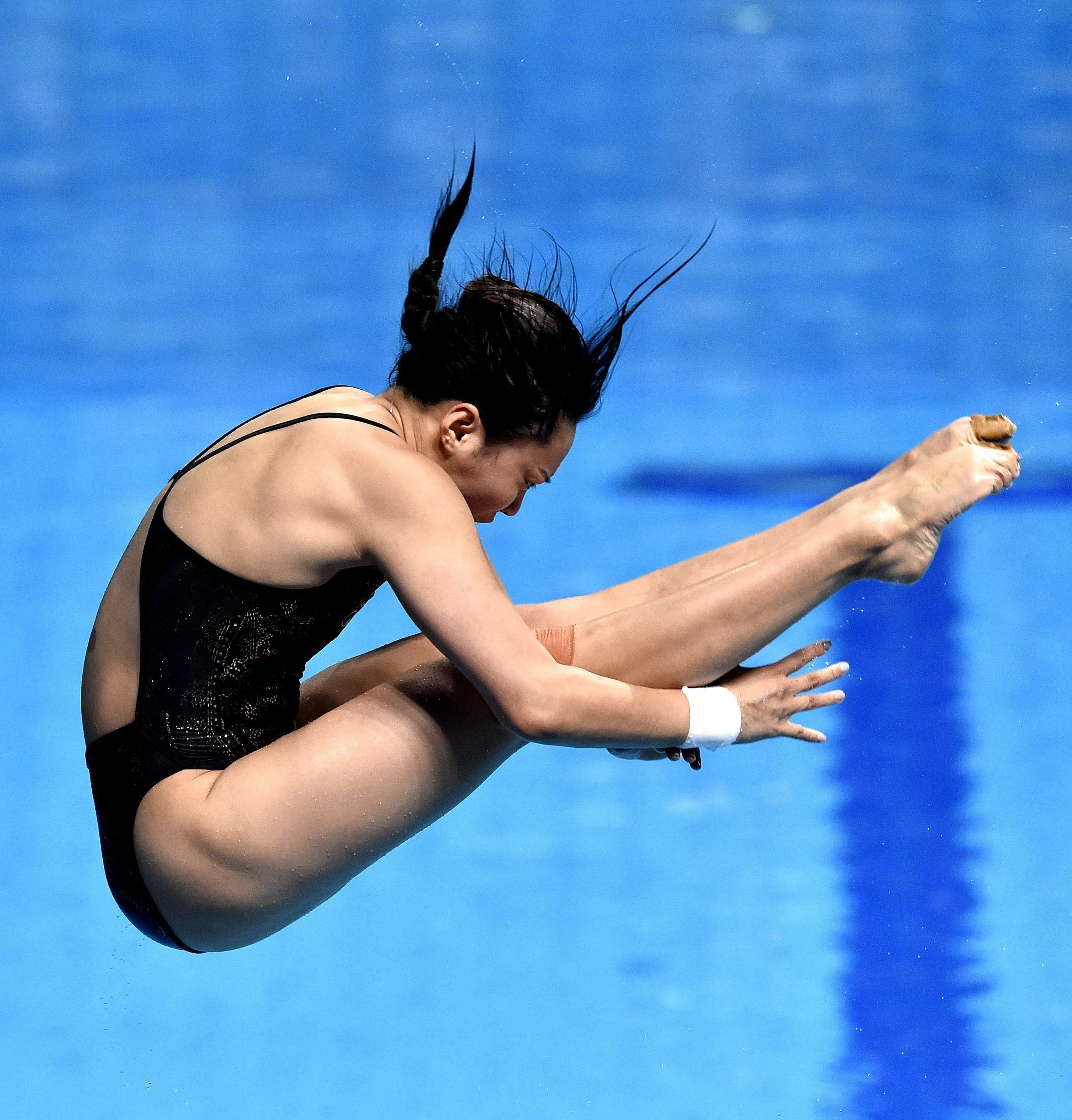 Han Wang of China competes in the women's diving 3m springboard semifinals of the 17th FINA Swimming World Championships in Duna Arena in Budapest, Hungary, Thursday, July 20, 2017. (Zoltan Mathe/MTI via AP)
