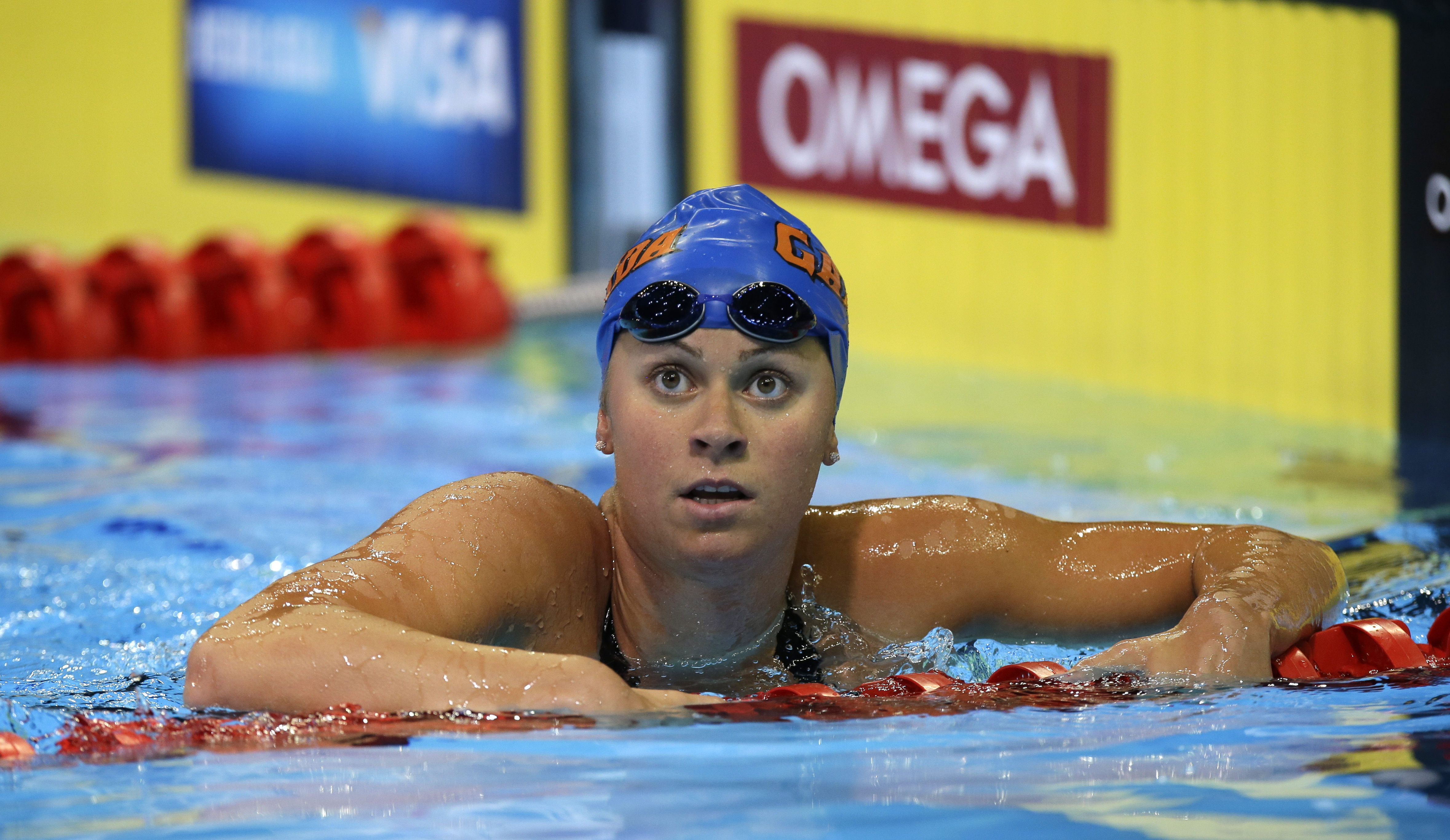 FILE -  In this Wednesday, June 27, 2012 file photo, Elizabeth Beisel swims in the women's 200-meter individual medley preliminaries at the U.S. Olympic swimming trials in Omaha, Neb. Matt Grevers and Elizabeth Beisel have been through this before. But th