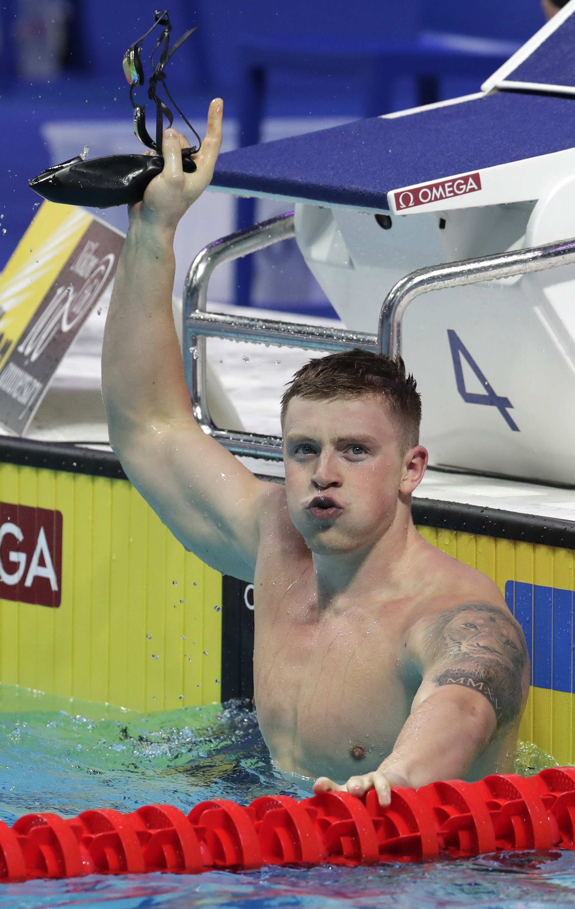 Britain's Adam Peaty celebrates after winning the gold medal in the men's 100-meter breaststroke final during the swimming competitions of the World Aquatics Championships in Budapest, Hungary, Monday, July 24, 2017. (AP Photo/Michael Sohn)