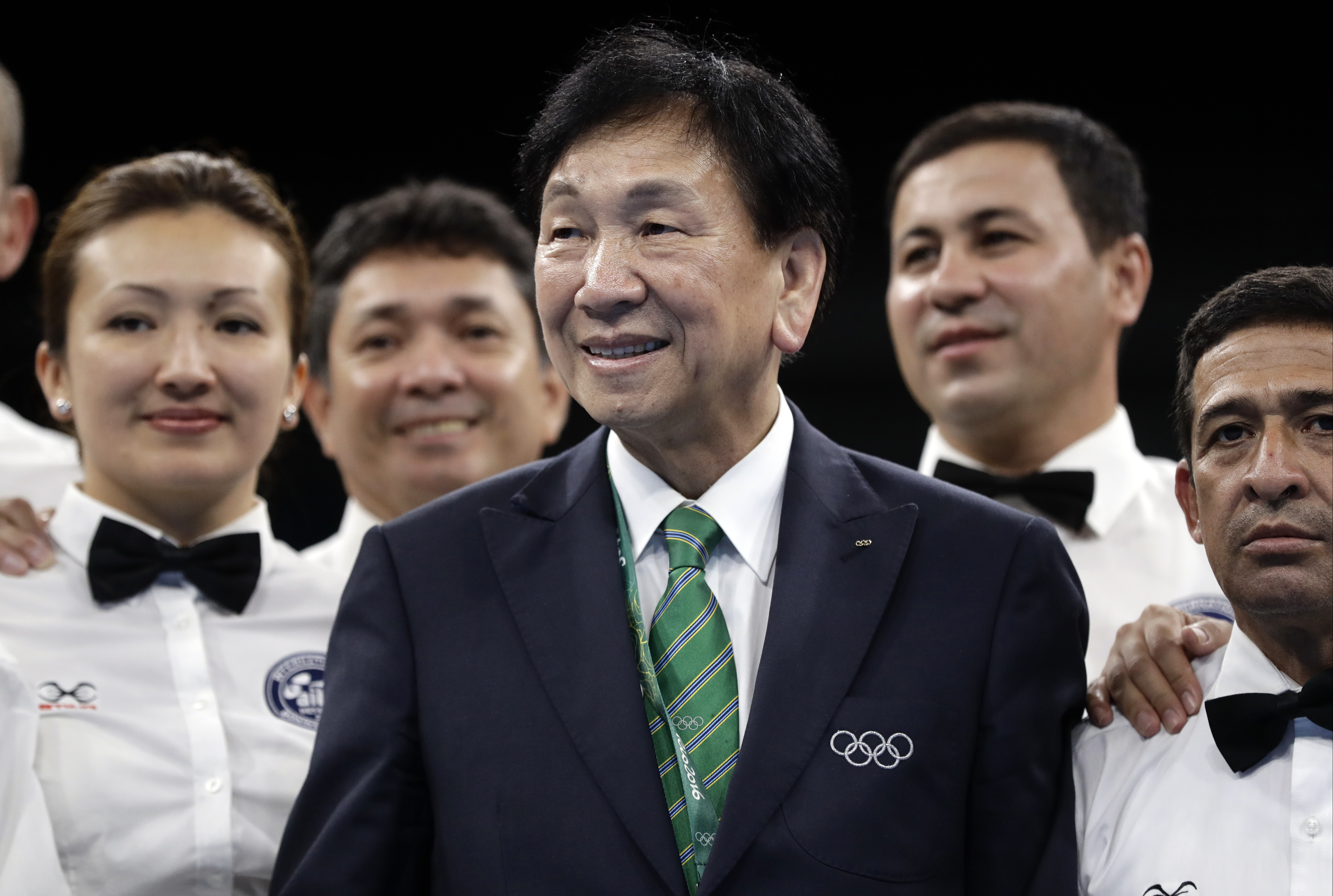 FILE - This a Sunday, Aug. 21, 2016 file photo of AIBA President Ching-Kuo Wu as he  poses for picture with referees in the ring after the final matches at the 2016 Summer Olympics in Rio de Janeiro, Brazil.  The embattled governing body of Olympic boxing