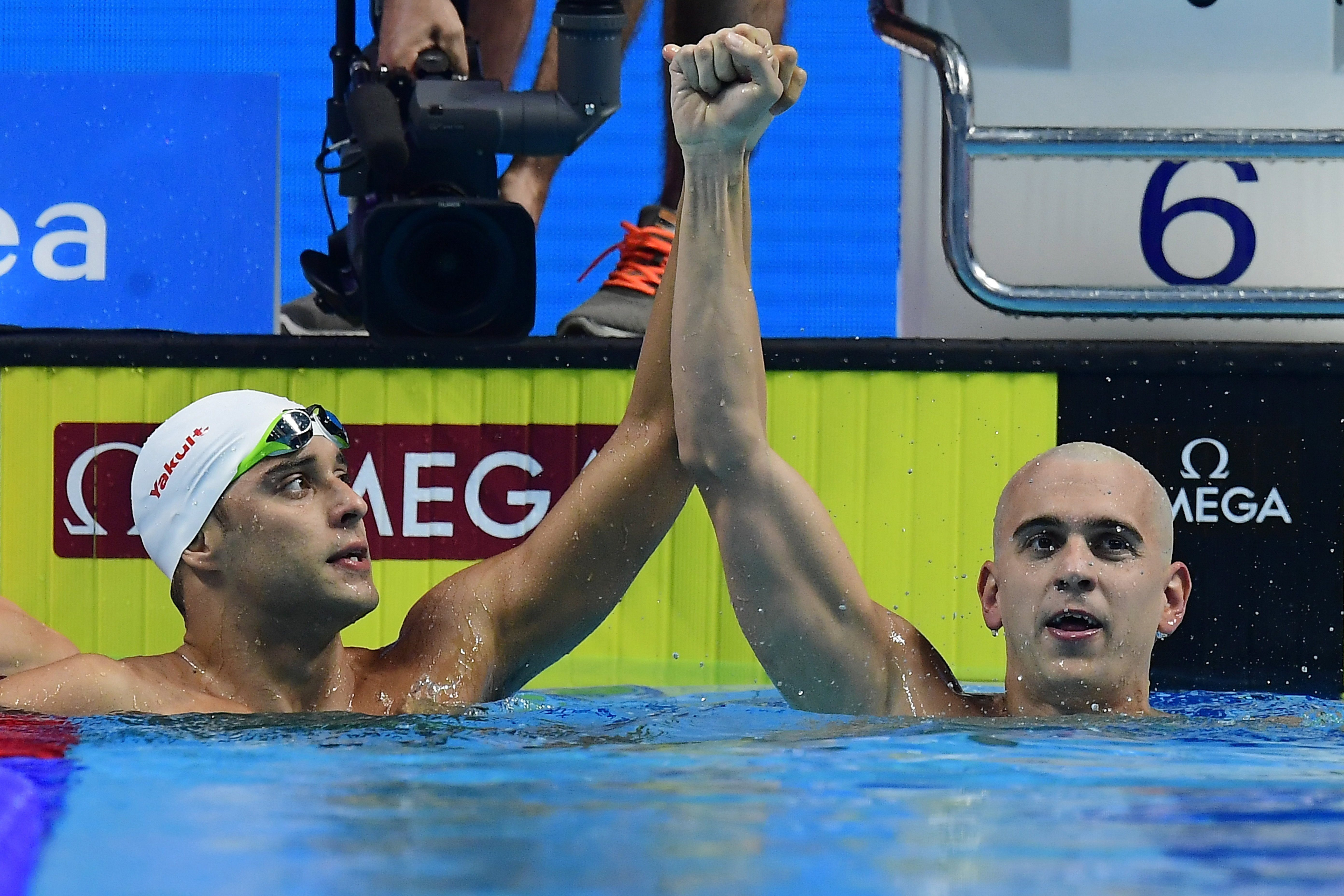 Gold medal winner Chad le Clos of South Africa, left, and Laszlo Cseh of Hungary react after the men's 200-meter butterfly final during the swimming competitions of the World Aquatics Championships in the Duna Arena in Budapest, Hungary, Wednesday, July 2