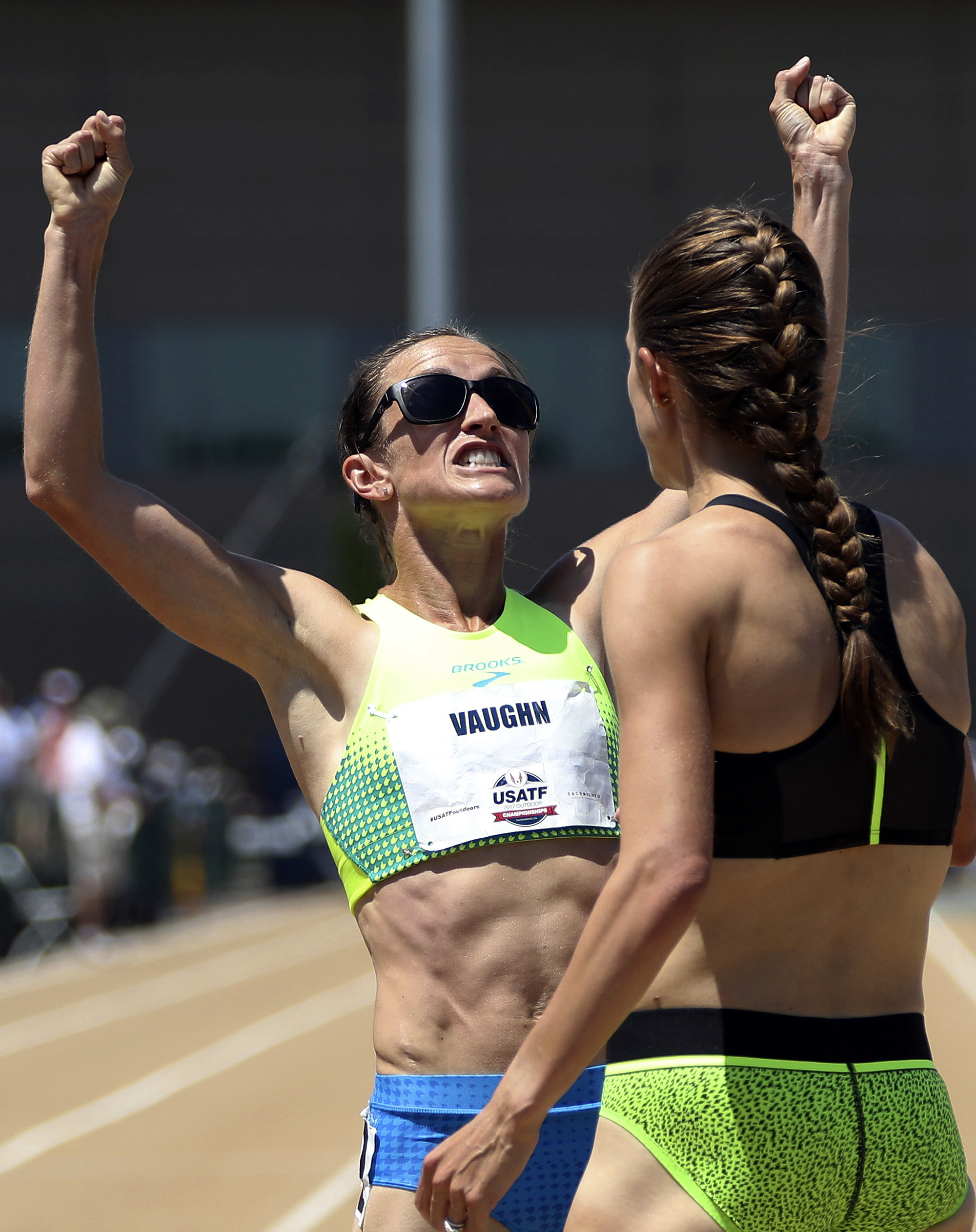 FILE - In this June 24, 2017, file photo, Sara Vaughn, left, celebrates after she finished third in the women's 1,500 meters at the U.S. Track and Field Championships in Sacramento, Calif., as first-place finisher Jenny Simpson, right, watches. Vaughn, a