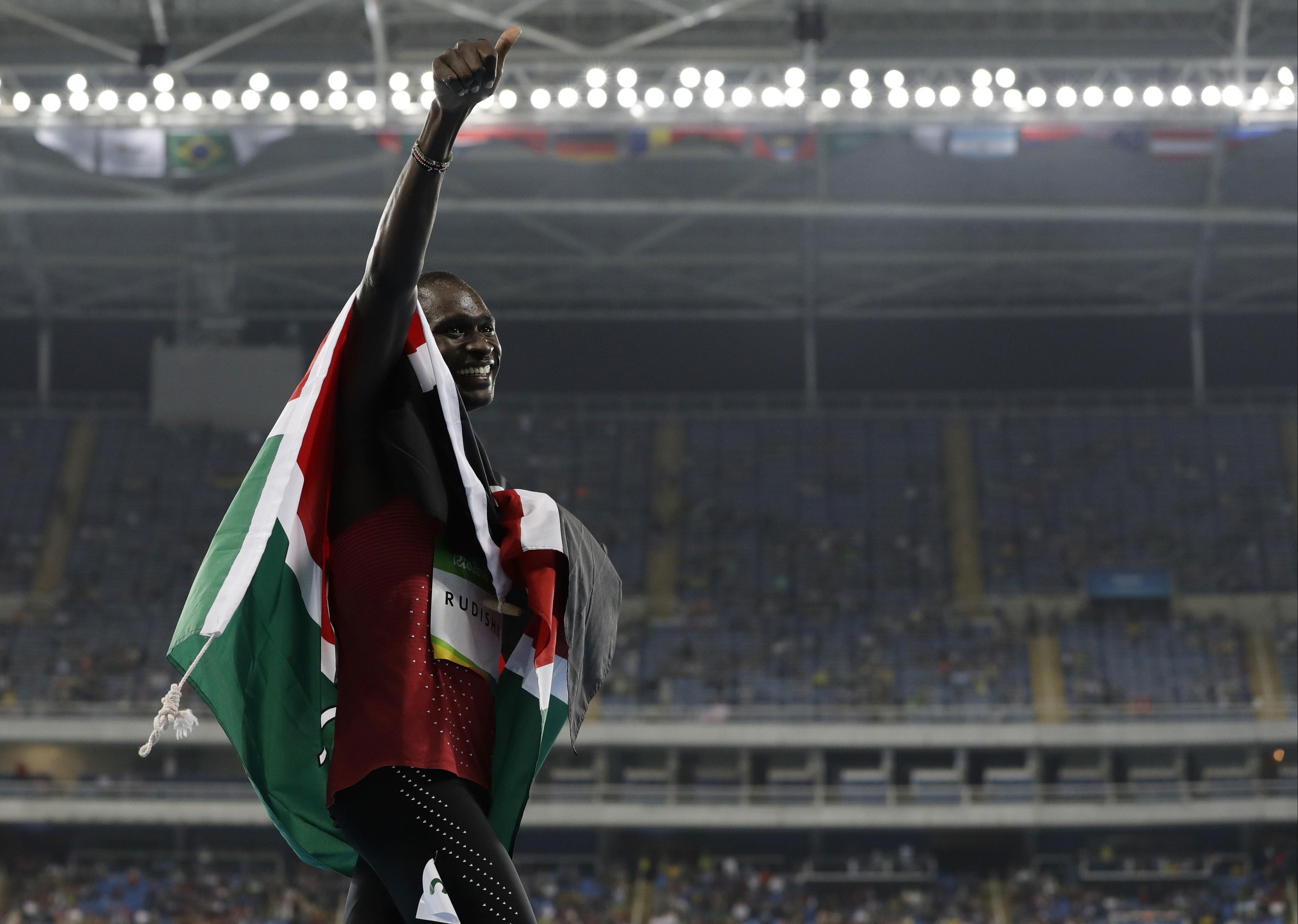 FILE - In this Monday, Aug. 15, 2016 file photo, Kenya's David Lekuta Rudisha celebrates winning the men's 800-meter final during the athletics competitions of the 2016 Summer Olympics at the Olympic stadium in Rio de Janeiro, Brazil. David Rudisha has wi