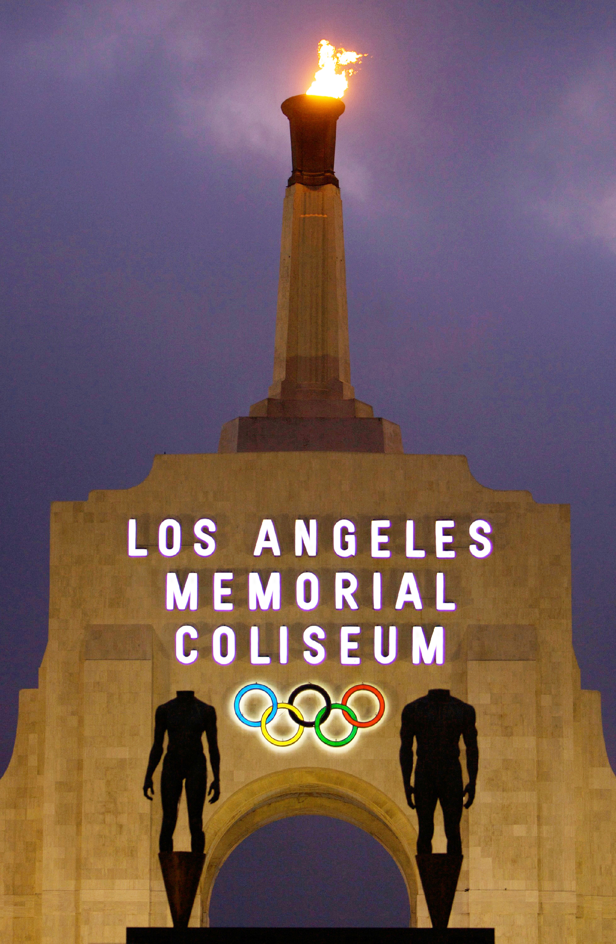 FILE - This Feb. 13, 2008, file photo shows the facade of The Los Angeles Memorial Coliseum in Los Angeles. It was announced Monday, July 31, 2017, that Los Angeles has reached an agreement with international Olympic leaders that will open the way for the