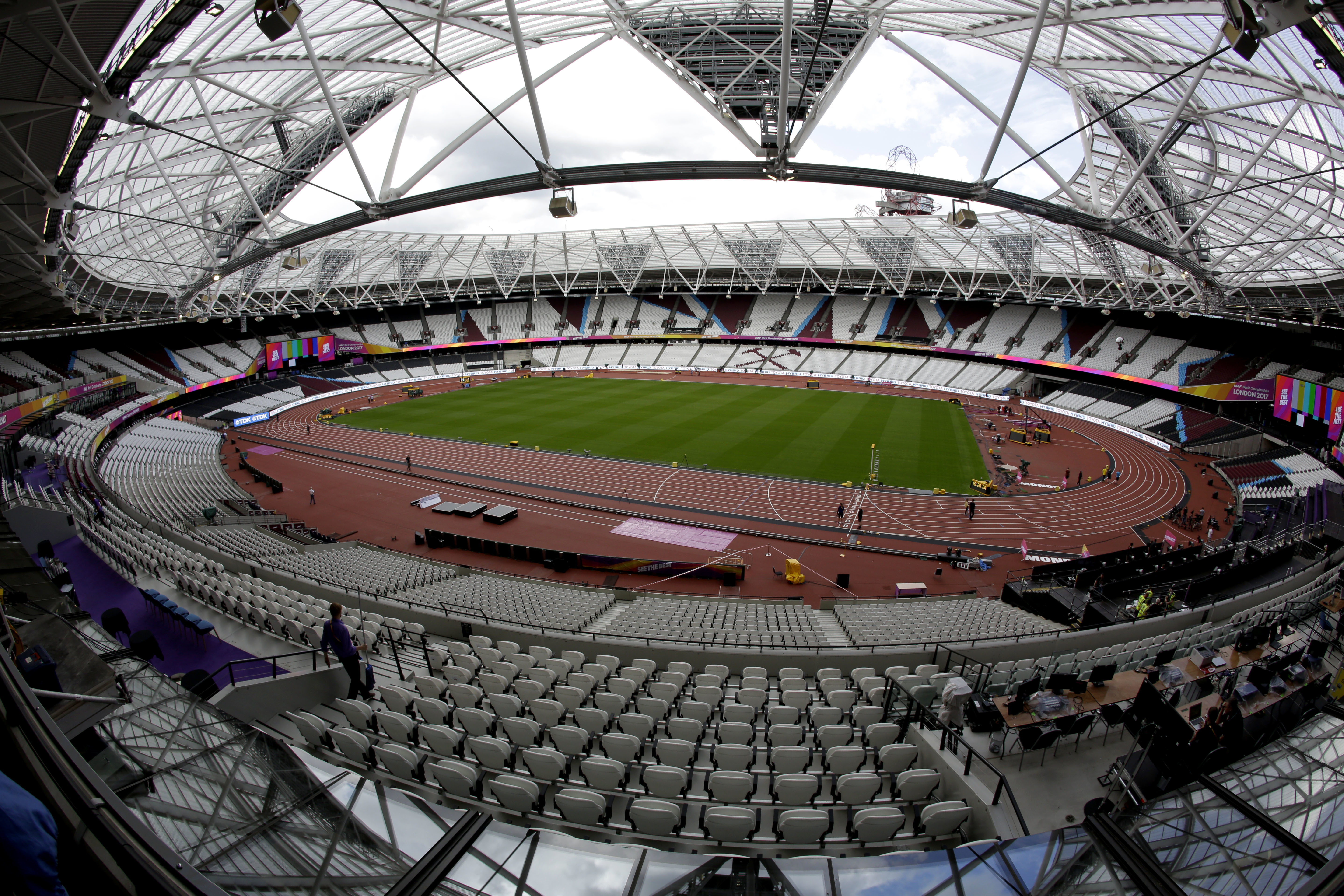 Workers continue setup preparations ahead of the start of the World Athletics Championships at the London Stadium, in the Queen Elizabeth Olympic Park in London, Tuesday, Aug. 1, 2017. The championships begin on Friday.(AP Photo/Matt Dunham)