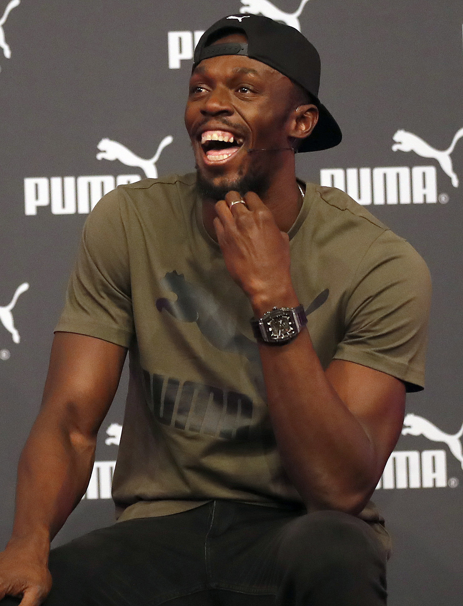Jamaican athlete Usain Bolt smiles during a press conference ahead of the World Athletics championships in London, Tuesday, Aug. 1, 2017. Sprint legend Bolt, a multiple Olympic and World Championship gold medallist, is set to retire after the World Champi