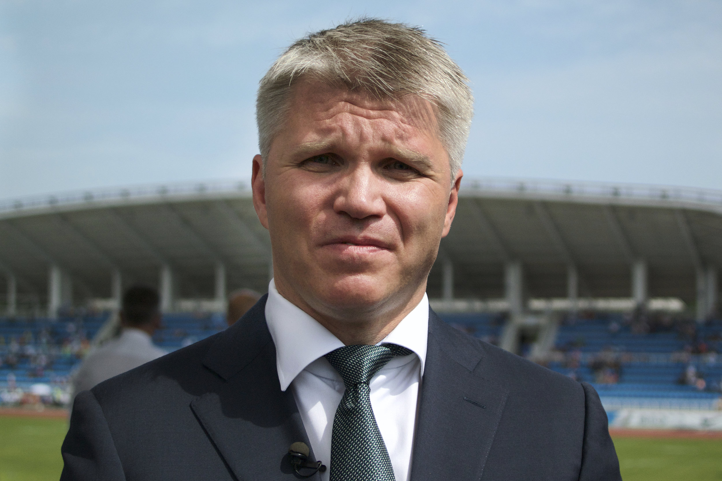 On this Friday, July 28, 2017 photo Russia's Sports Minister Pavel Kolobkov speaks to the media during the national track and field championship in Moscow, just outside Moscow, Russia. Russian athletes won't hear their national anthem if they win and thei