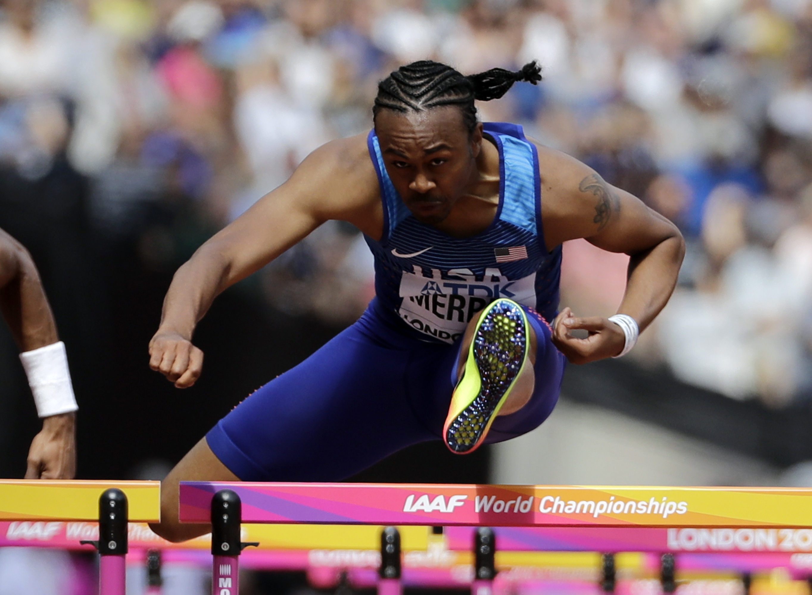 United States' Aries Merritt competes in a men's 110-meter hurdles first round heat during the World Athletics Championships in London Sunday, Aug. 6, 2017. (AP Photo/David J. Phillip)