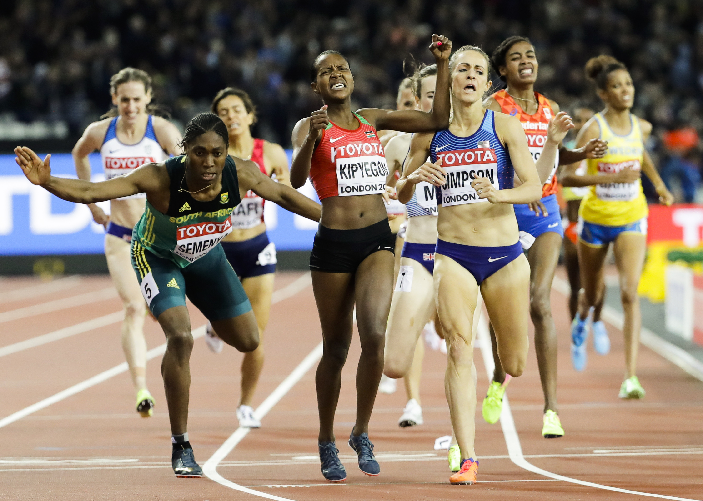 Kenya's Faith Chepngetich Kipyegon, center, celebrates as she wins the gold medal in the final of the Woman's 1500m during the World Athletics Championships in London Monday, Aug. 7, 2017. Others from left are: South Africa's Caster Semenya, bronze, and U