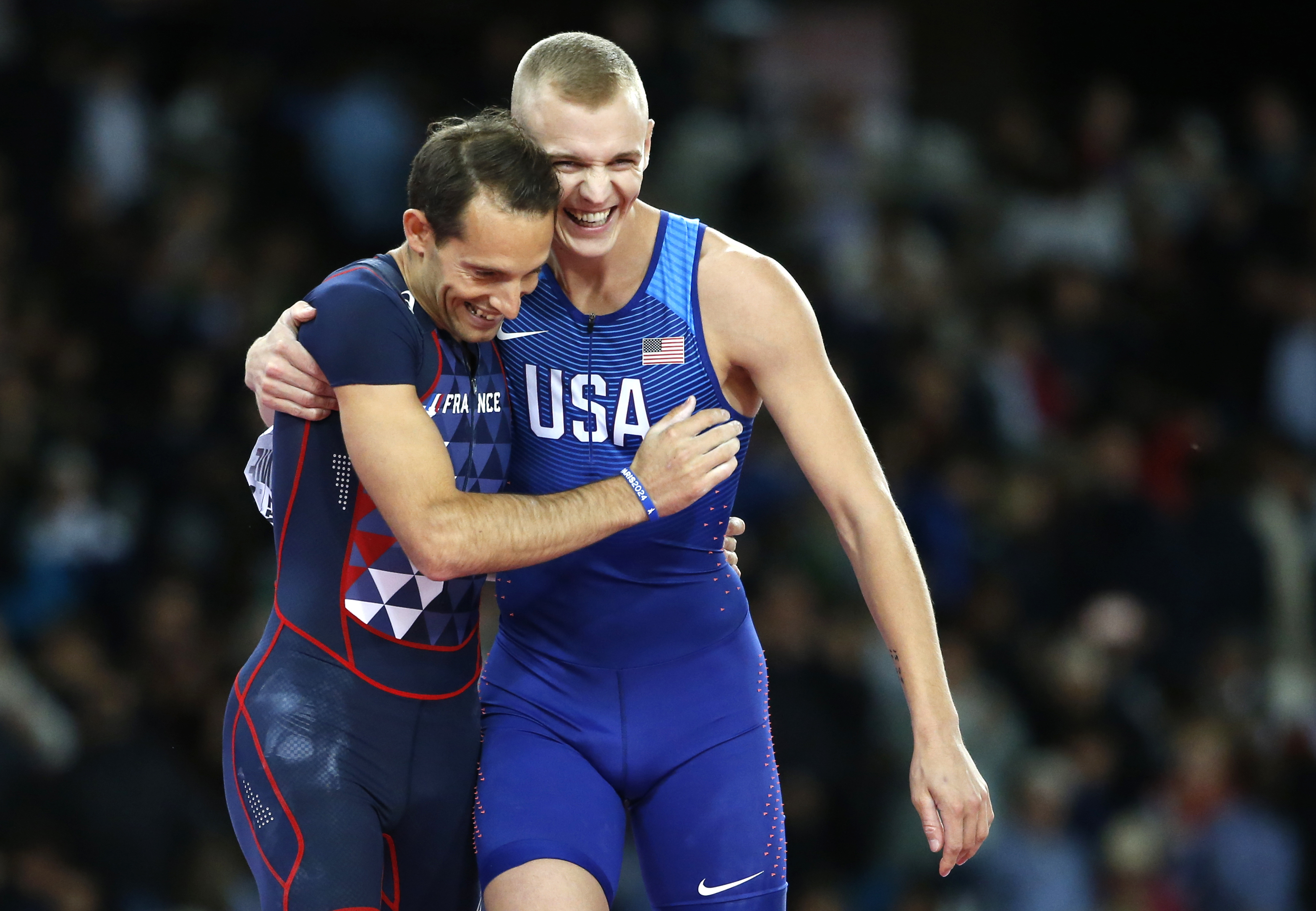 France's bronze medal winner Renaud Lavillenie, left, and United States' gold medal winner Sam Kendricks congratulate each other after the men's pole vault final during the World Athletics Championships in London Tuesday, Aug. 8, 2017. (AP Photo/Matthias