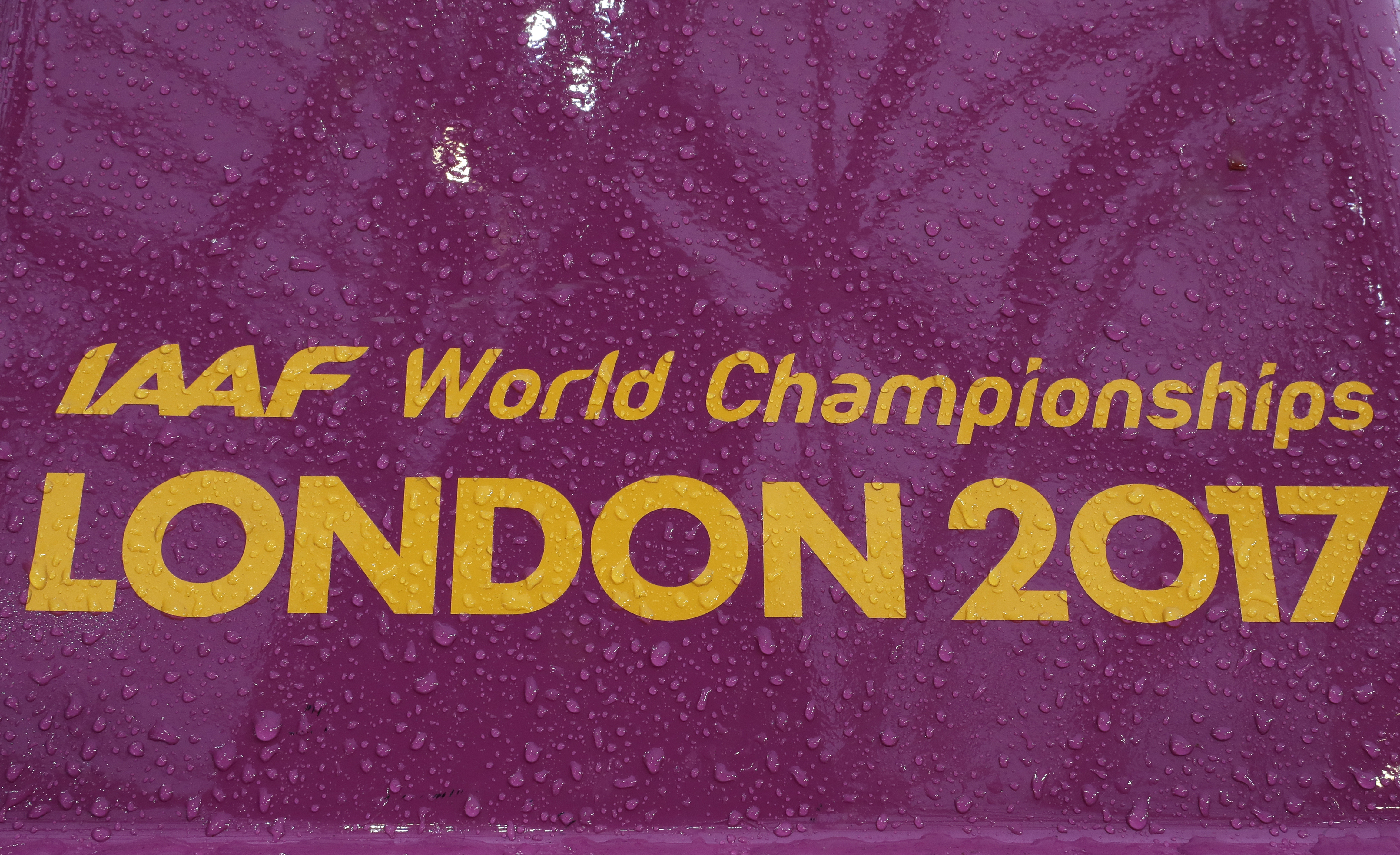 Raindrops sit on a starting block when rain pours down during the World Athletics Championships in London Wednesday, Aug. 9, 2017. (AP Photo/David J. Phillip)