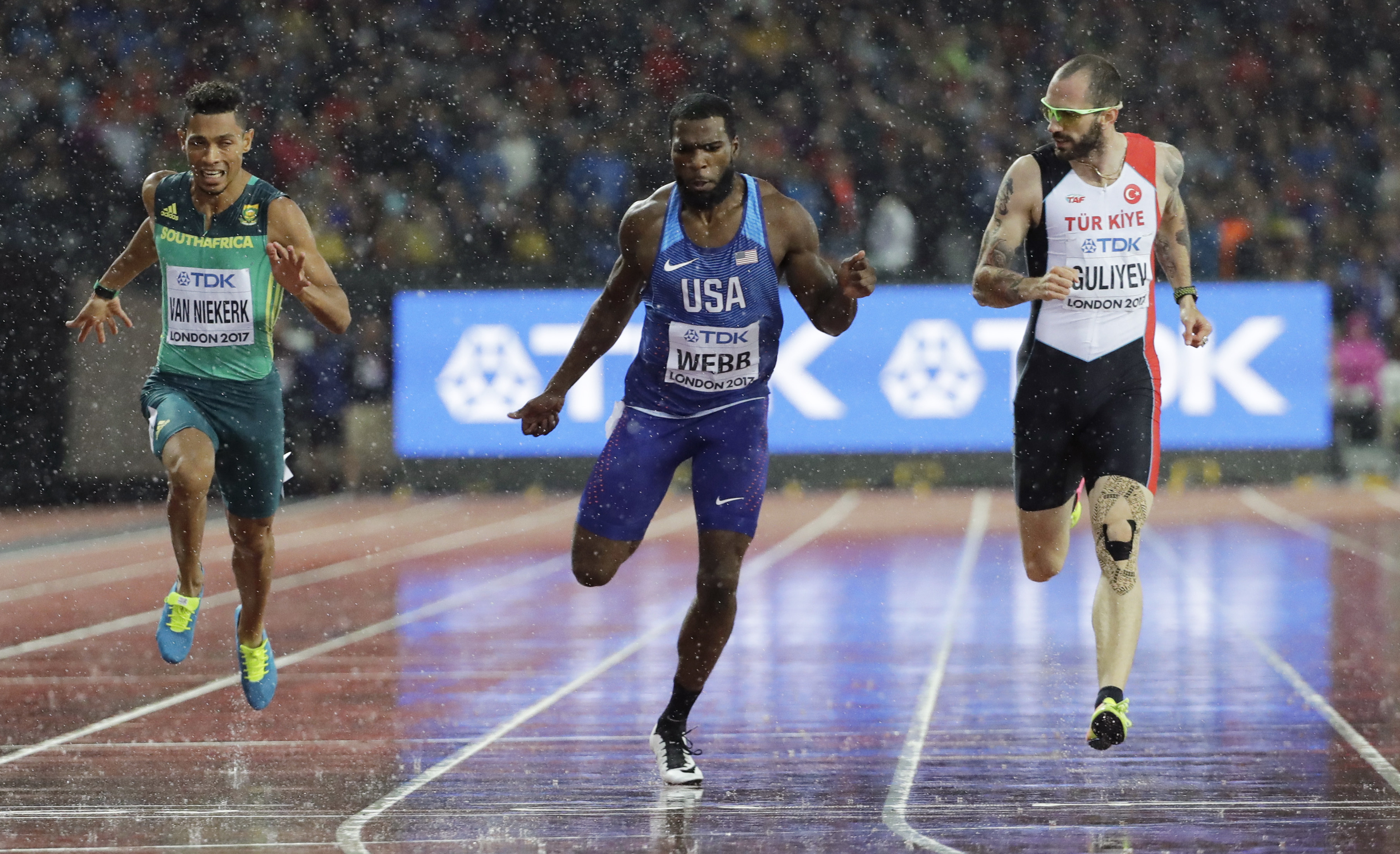 Turkey's Ramil Guliyev, United States' Ameer Webb and South Africa's Wayde van Niekerk cross the line in a Men's 200m semifinal during the World Athletics Championships in London Wednesday, Aug. 9, 2017. (AP Photo/David J. Phillip)