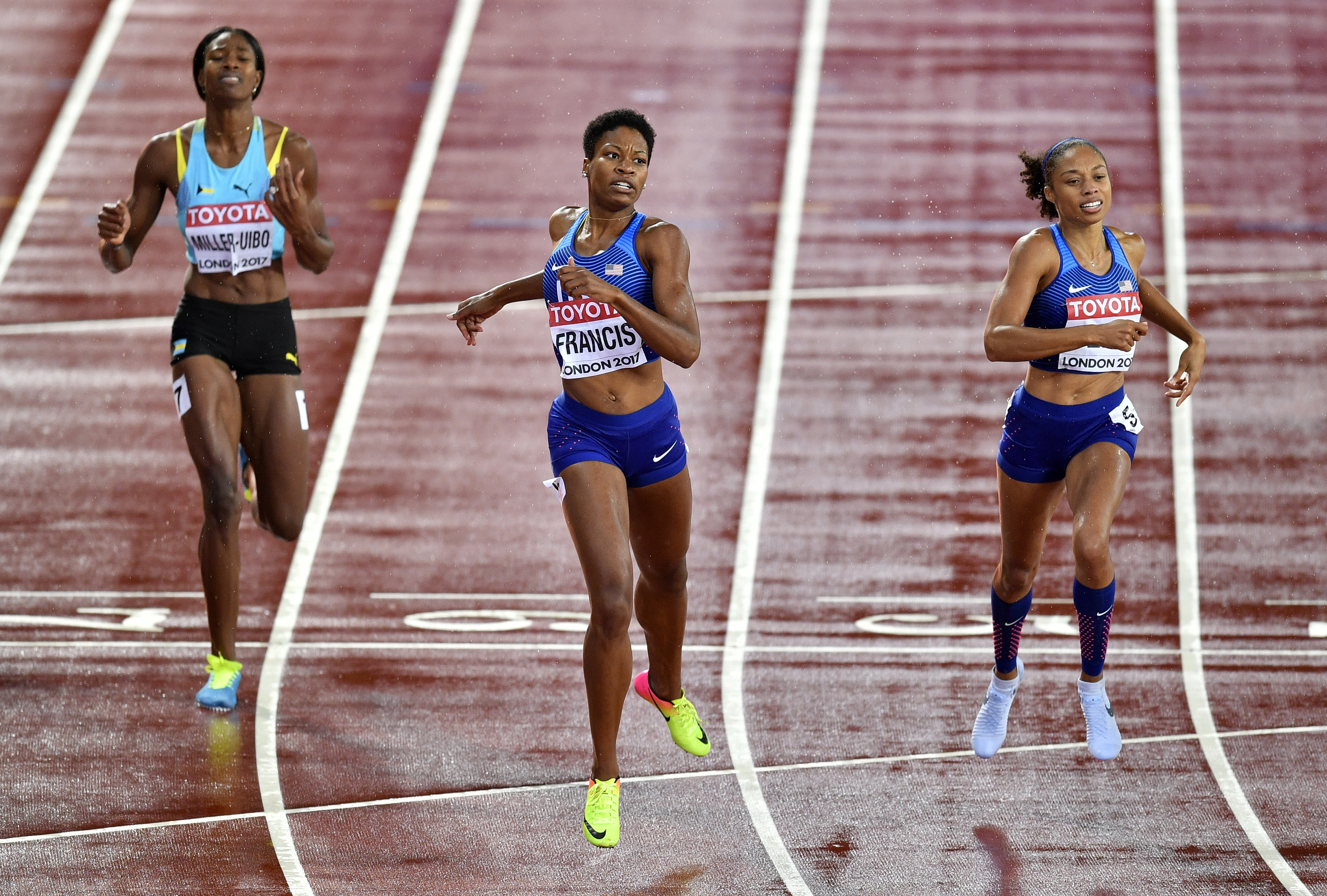 United States' Phyllis Francis, second left, crosses the finish line to win the Women's 400 meters final head of third placed compatriot Allyson Felix, right, and Bahamas' Shaunae Miller-Uibo at the World Athletics Championships in London Wednesday, Aug.