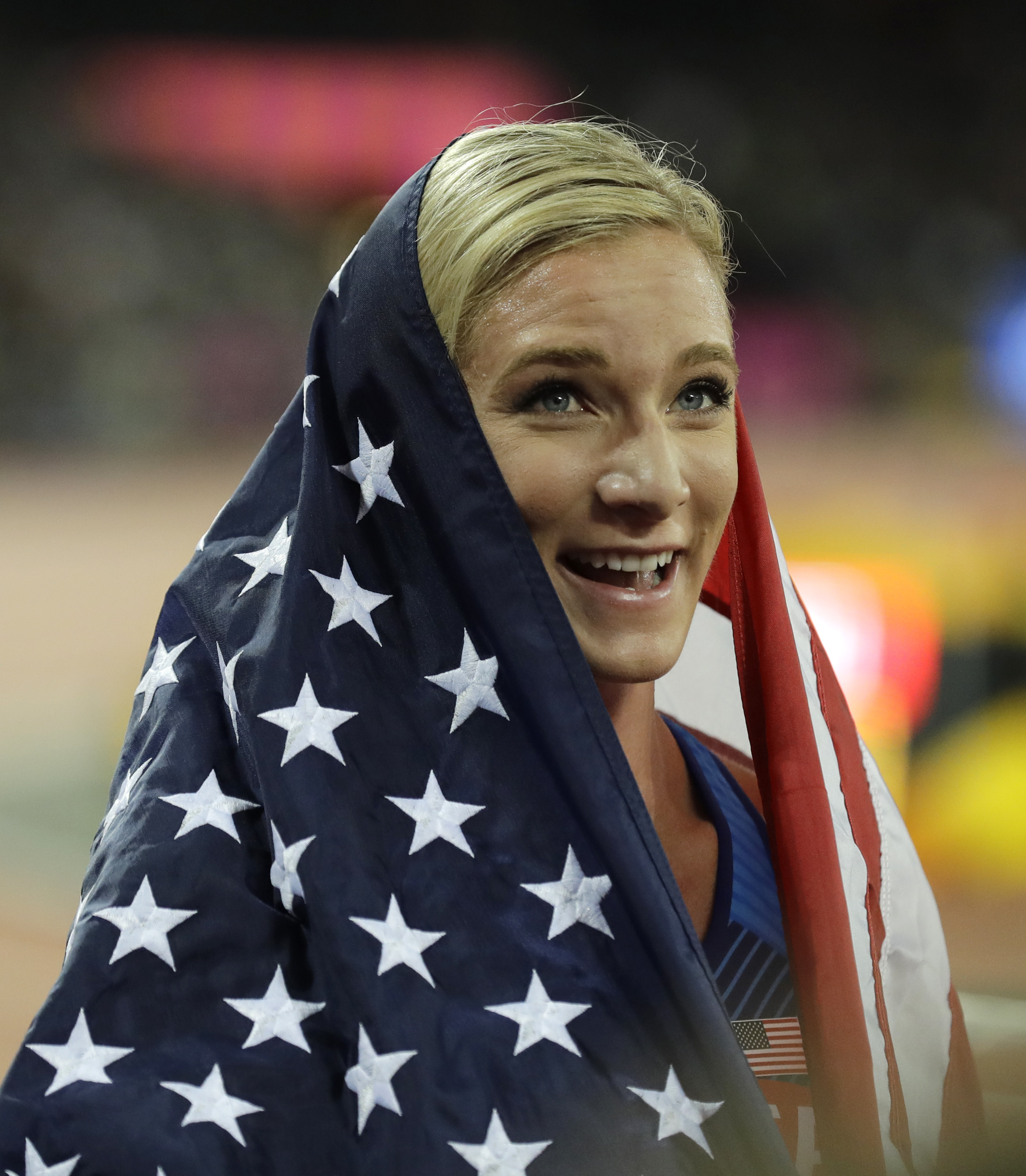 United States' Emma Coburn celebrates after winning the Women's 3000 meter steeplechase final during the World Athletics Championships in London Friday, Aug. 11, 2017. (AP Photo/Tim Ireland)