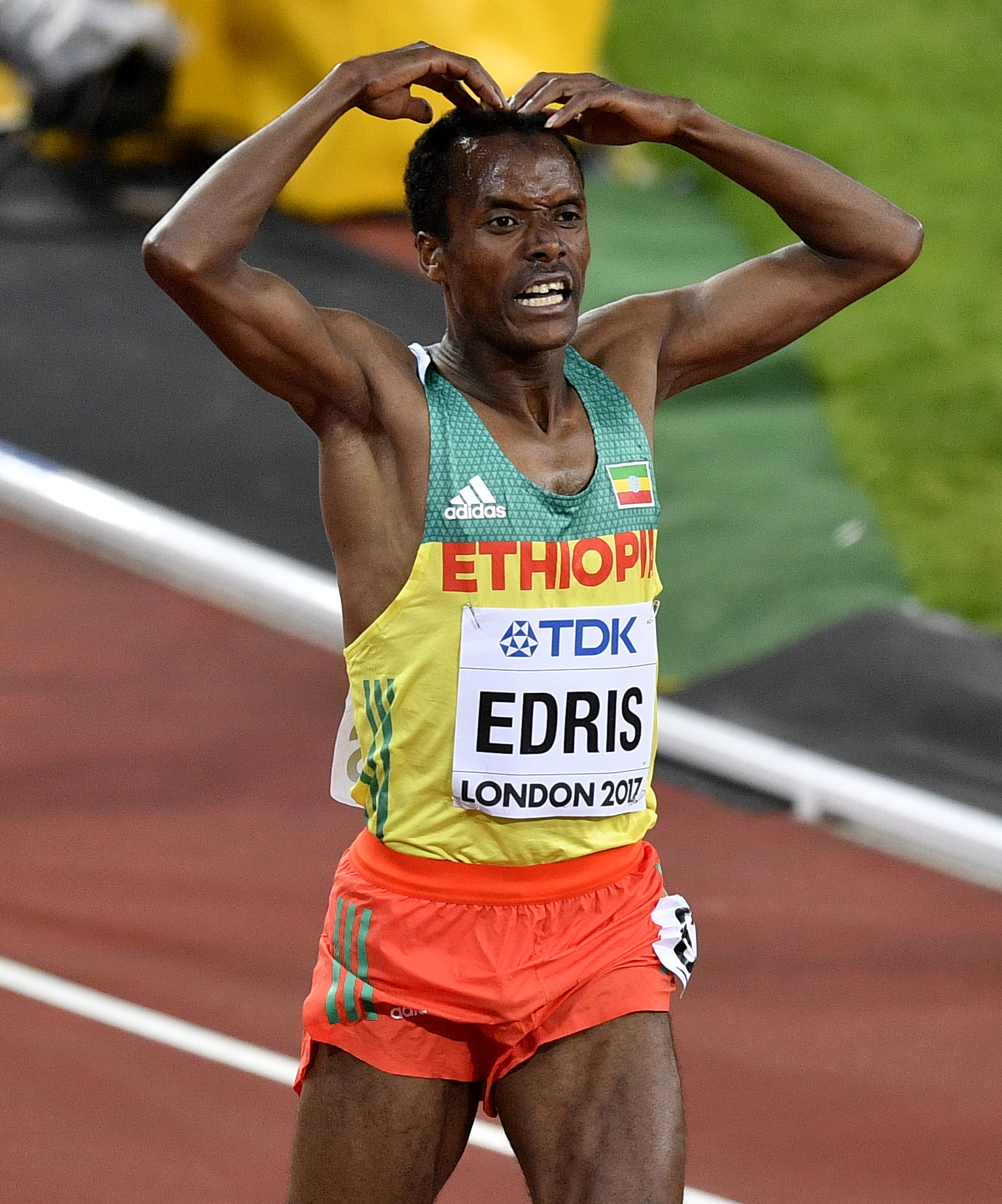 Ethiopia's Muktar Edris celebrates after winning the Men's 5000 meters final at the World Athletics Championships in London Saturday, Aug. 12, 2017. (AP Photo/Martin Meissner)