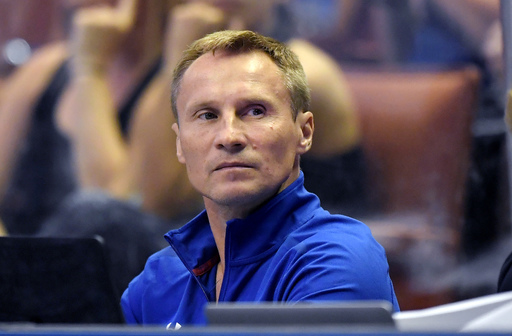 Valeri Liukin watches during women's Round 1 of the USA Gymnastics championships, Friday, Aug. 18, 2017, in Anaheim, Calif. Liukin insists the expectations for the U.S. women's gymnastics program have not changed now that he's taken over for the retired M