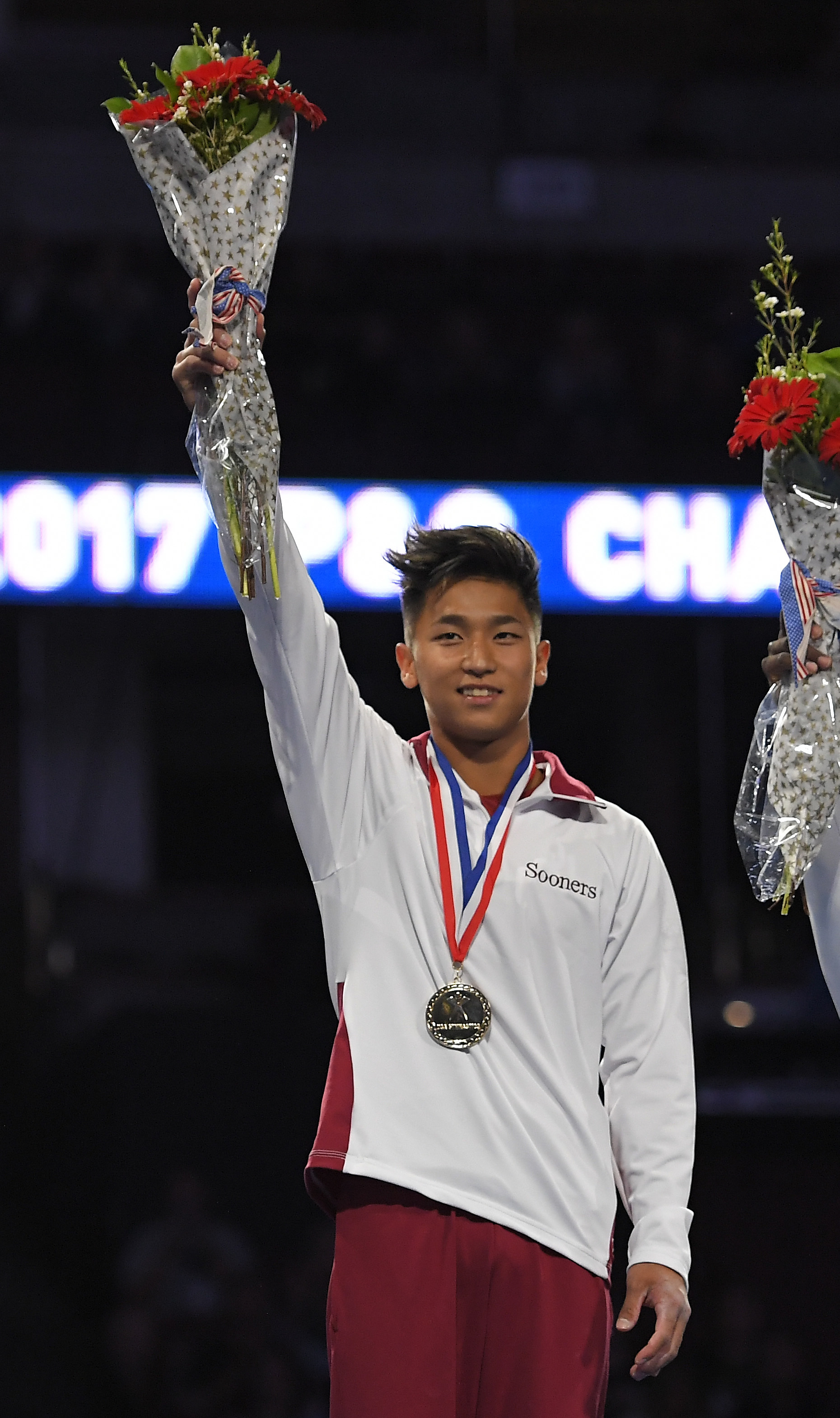 Yul Moldauer waves to fans after winning the men's all-around at the U.S. gymnastics championships, Saturday, Aug. 19, 2017, in Anaheim, Calif. (AP Photo/Mark J. Terrill)