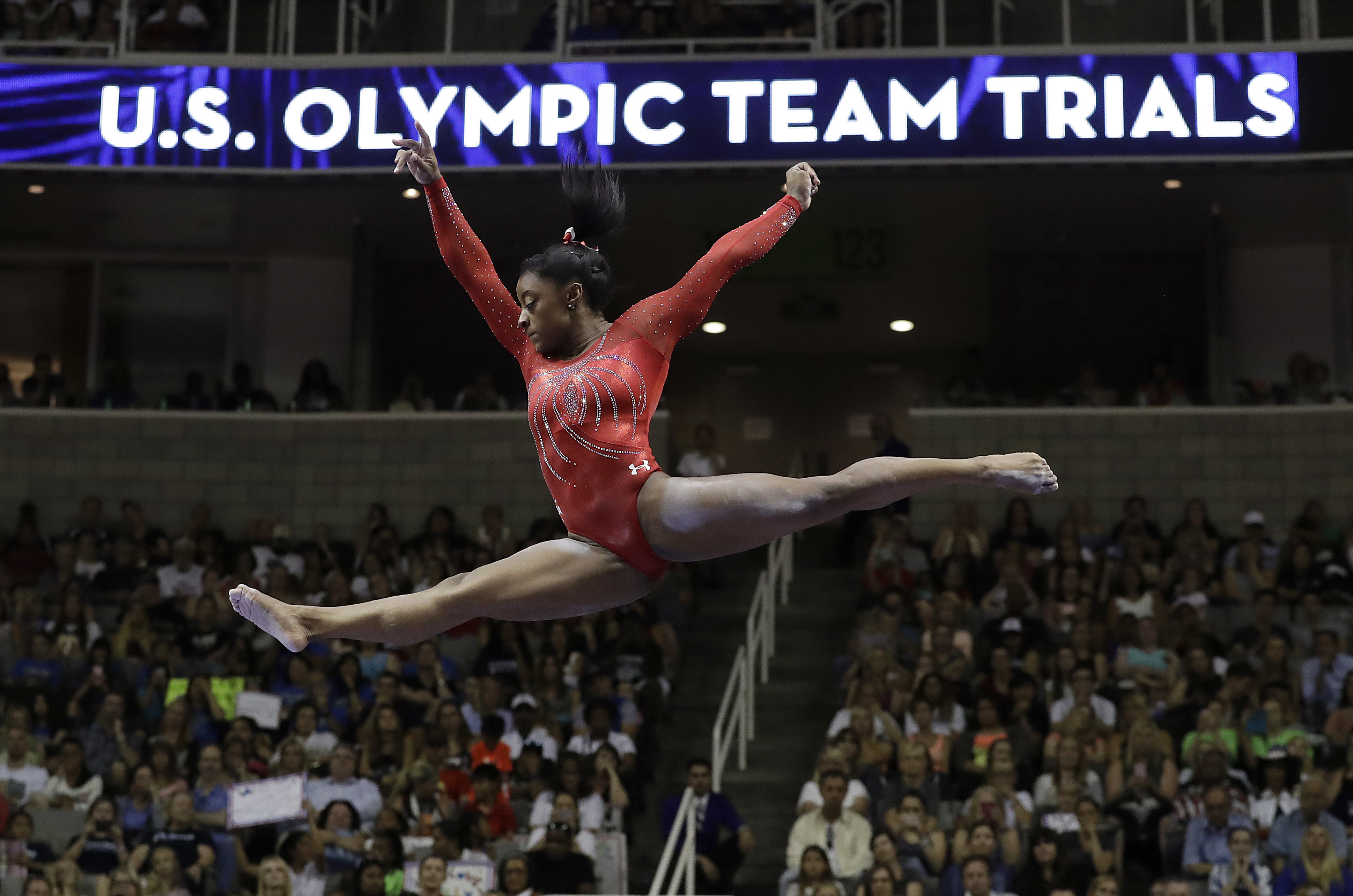 FILE - In this Sunday, July 10, 2016, file photo, Simone Biles competes on the balance beam during the women's U.S. Olympic gymnastics trials in San Jose, Calif. Biles, who won four gold medals at the 2016 Summer Games, says she is just testing the waters