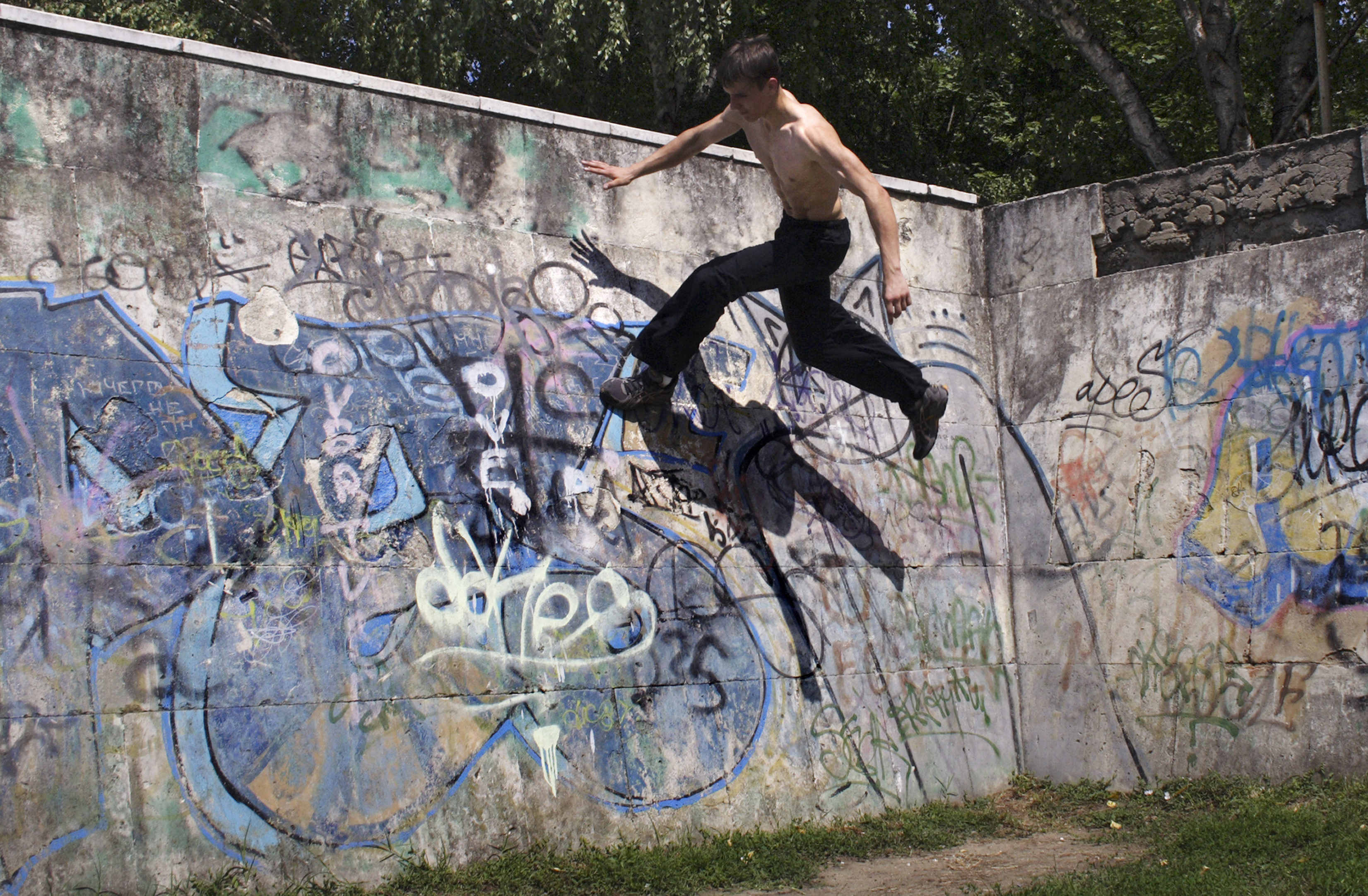 FILE - A Thursday, Aug. 6, 2009 file photo of a Parkour practitioner jumping in the southern Russian city of Krasnodar, about 1,200 km (750 miles) south of Moscow. Global organizers of street-running known as parkour have set the International Gymnastics