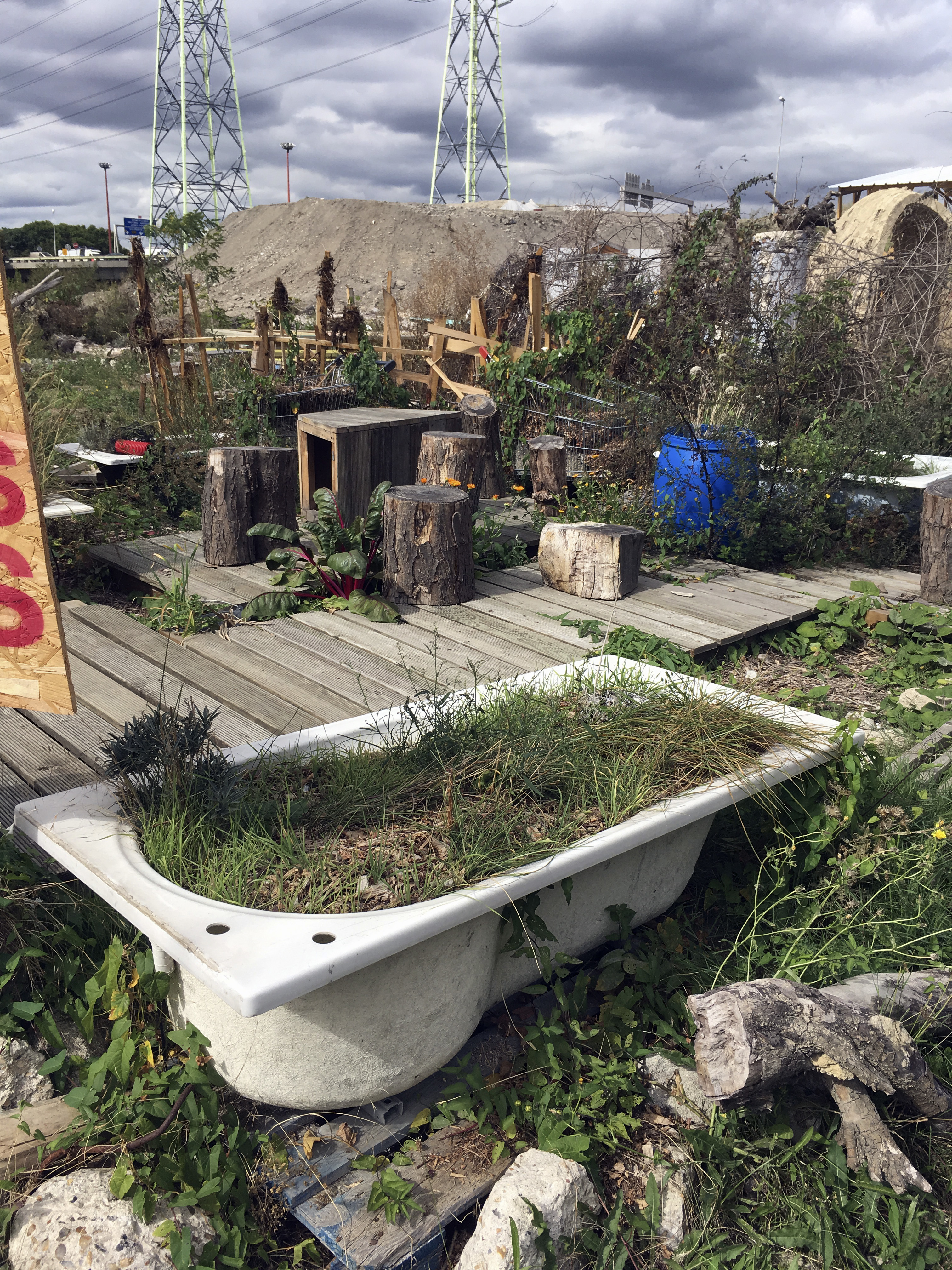 In this Monday, Sept. 4, 2017 photo, a bathtub lays on the site where the future Olympic Village for athletes will be built when Paris holds the games in 2024, in Saint-Denis, north of Paris. The International Olympic Committee is expected at a meeting We