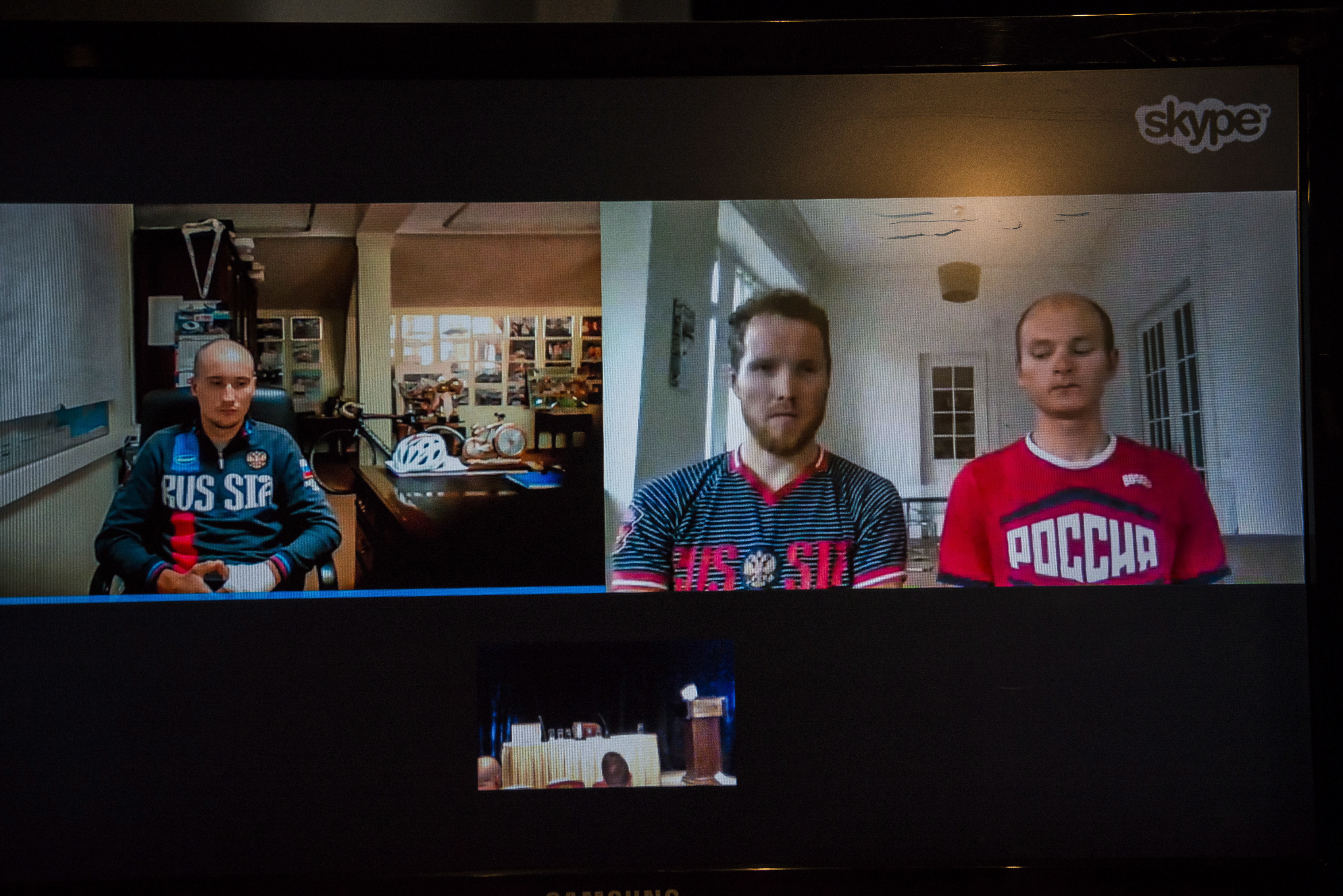 Russian cyclists, Kirill Sveshnikov, left, Dmitry Sokolov, center, and Dmitry Strakhov appear via teleconference after filing suit in the Ontario Superior Court of Justice against the World Anti-Doping Association, in Toronto, on Monday, Sept. 11, 2017. (