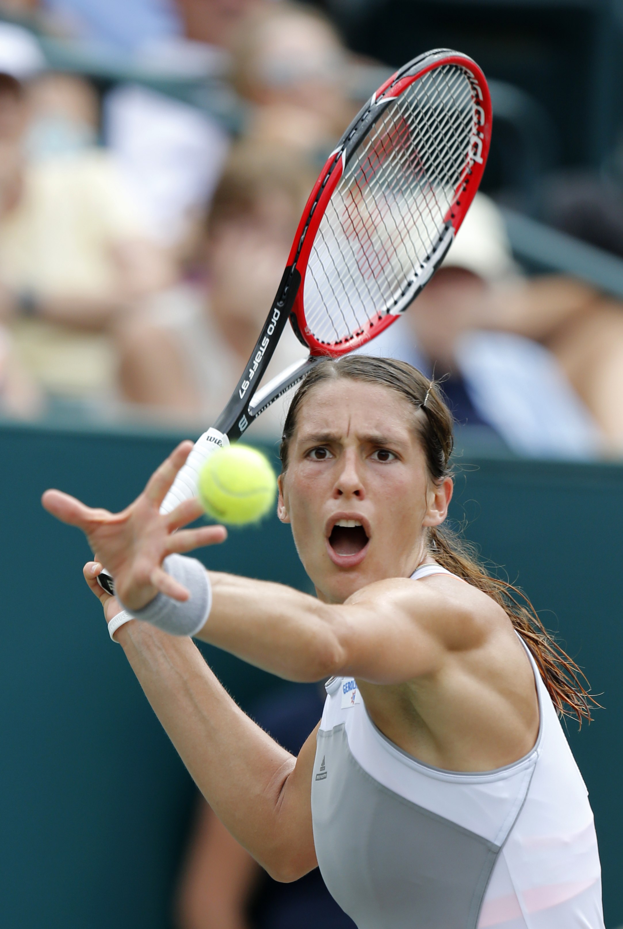 Andrea Petkovic, from Germany, returns to Angelique Kerber during semifinal action at the Family Circle Cup tennis tournament in Charleston, S.C., Saturday, April 11, 2015. Kerber won 6-4, 6-4. (AP Photo/Mic Smith)