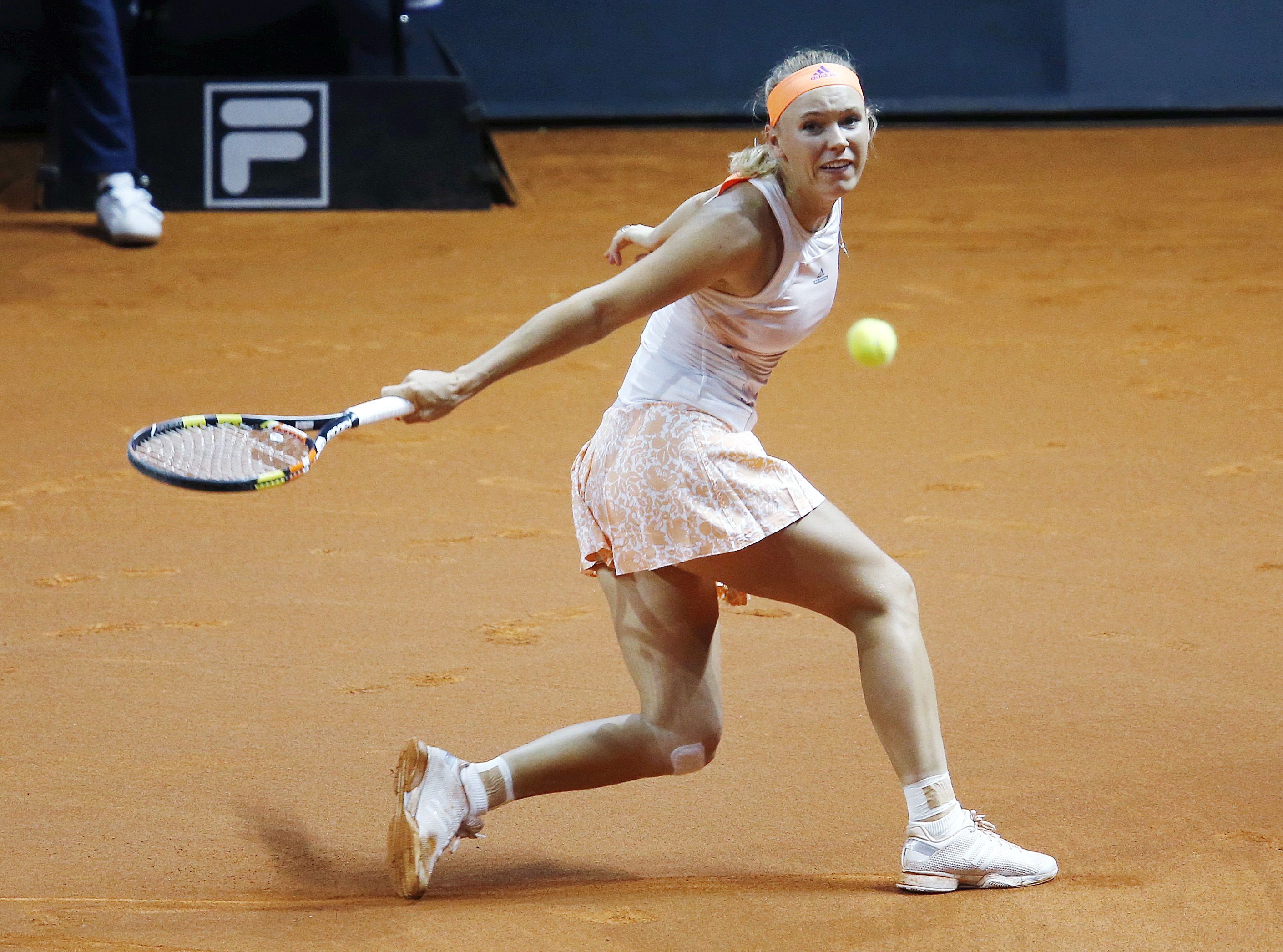 Denmark's Caroline Wozniacki hits a backhand against Germany's Angelique Kerber in their final match at the Porsche Grand Prix tennis tournament in Stuttgart, Germany, Sunday, April 26, 2015. (AP Photo/Michael Probst)