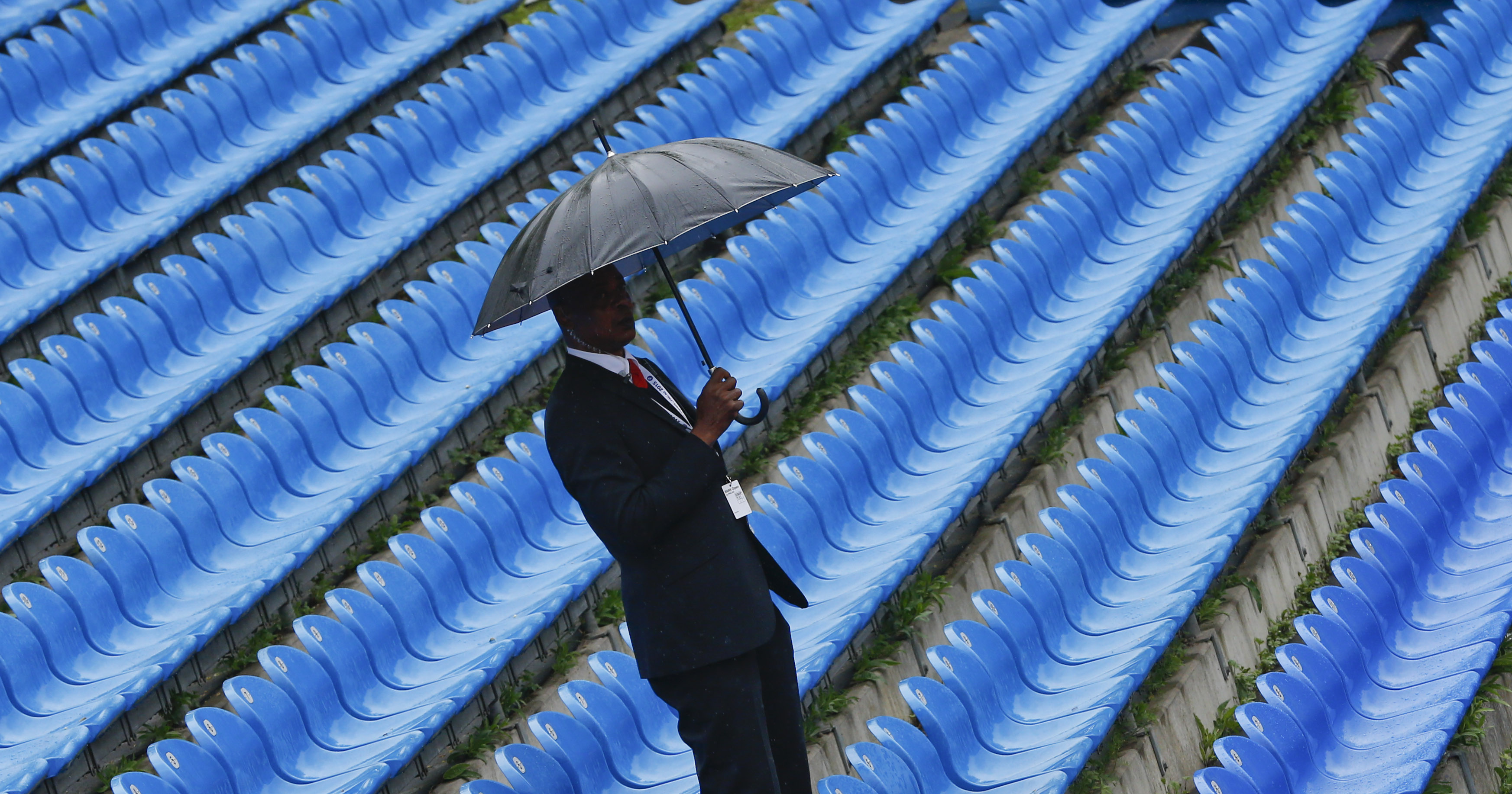 A security employee waits during a rain delay before the first quarterfinal match at the BMW Open tennis tournament in Munich, Germany, on Friday, May 1, 2015. (AP Photo/Matthias Schrader)
