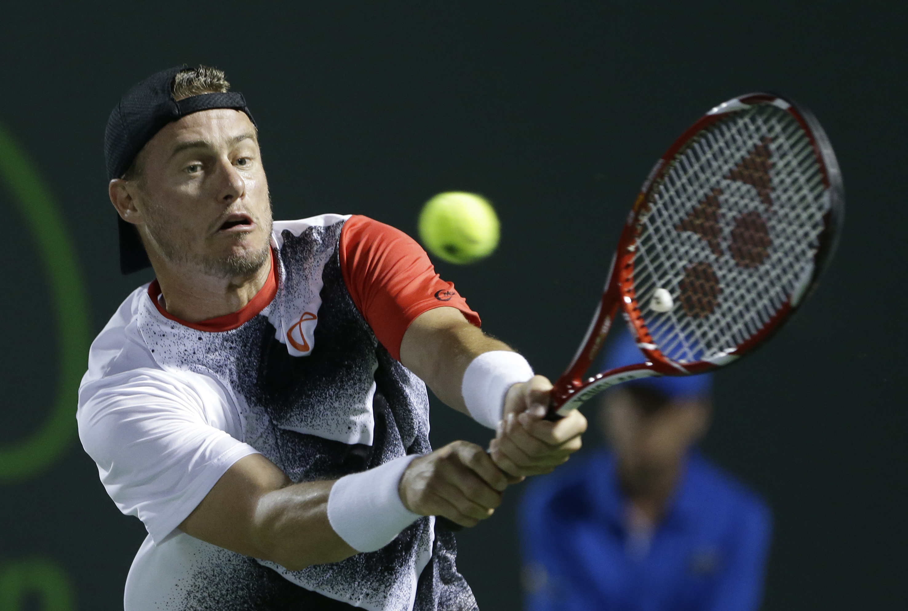 Lleyton Hewitt of Australia, returns a shot from Thomaz Bellucci of Brazil, at the Miami Open tennis tournament, Thursday, March 26, 2015 in Key Biscayne, Fla. (AP Photo/Wilfredo Lee)