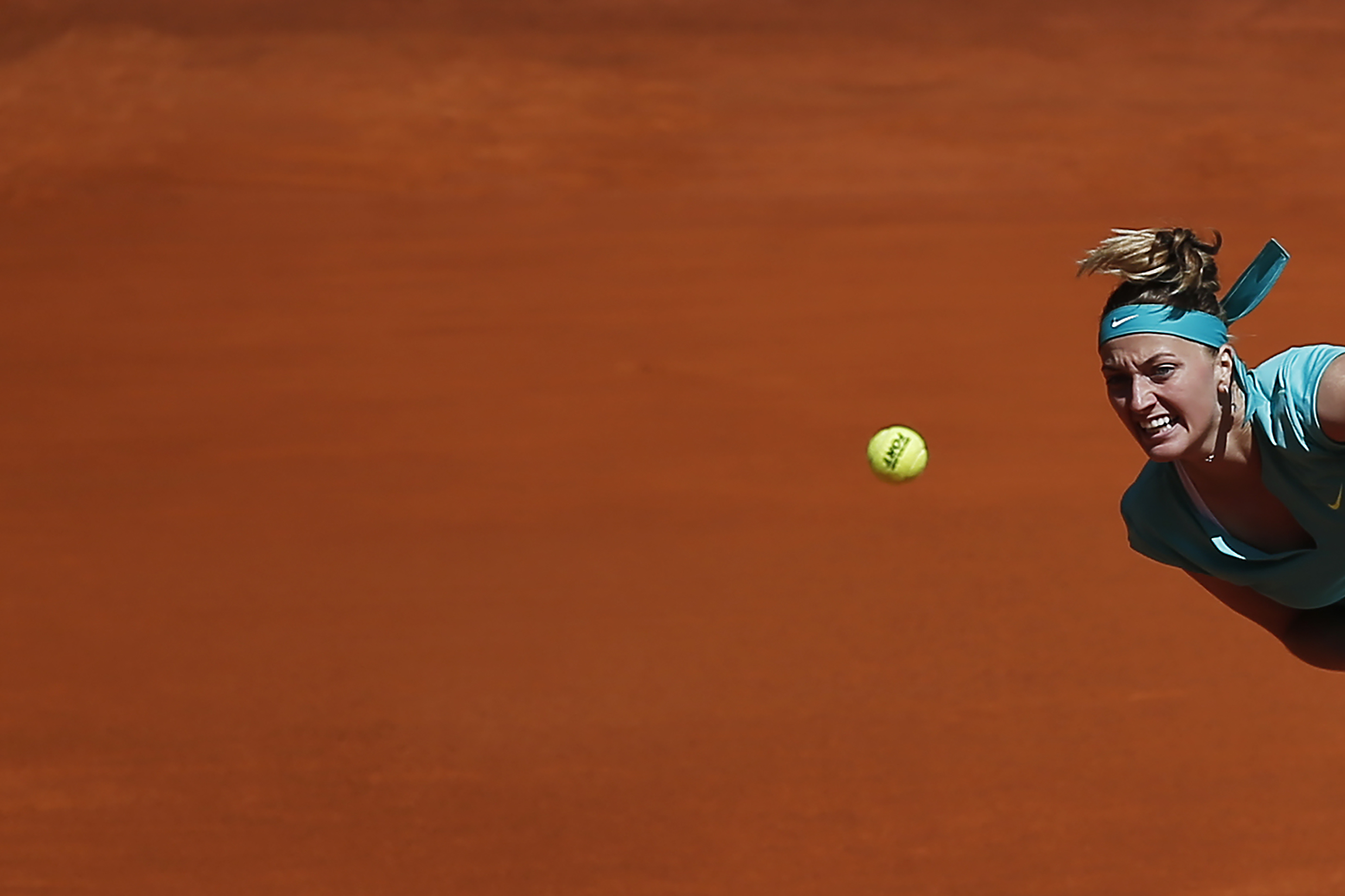 Petra Kvitova from Czech Republic serves during her Madrid Open tennis tournament match against Coco Vandeweghe from US in Madrid, Spain, Tuesday, May 5, 2015. (AP Photo/Andres Kudacki)