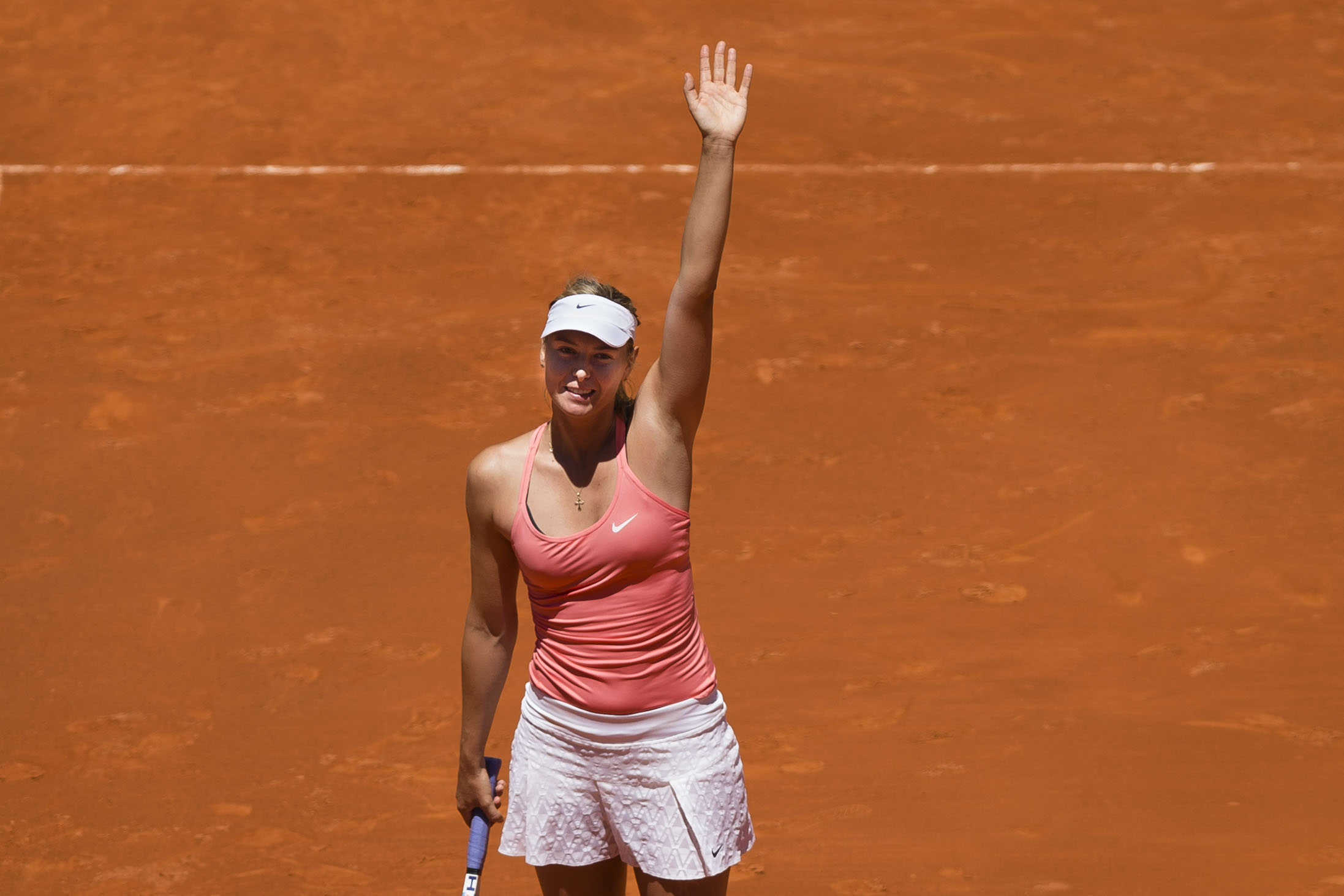 Maria Sharapova from Russia waves after defeating Caroline Garcia from France after their Madrid Open tennis tournament match in Madrid, Spain, Wednesday, May 6, 2015. (AP Photo/Daniel Ochoa de Olza)