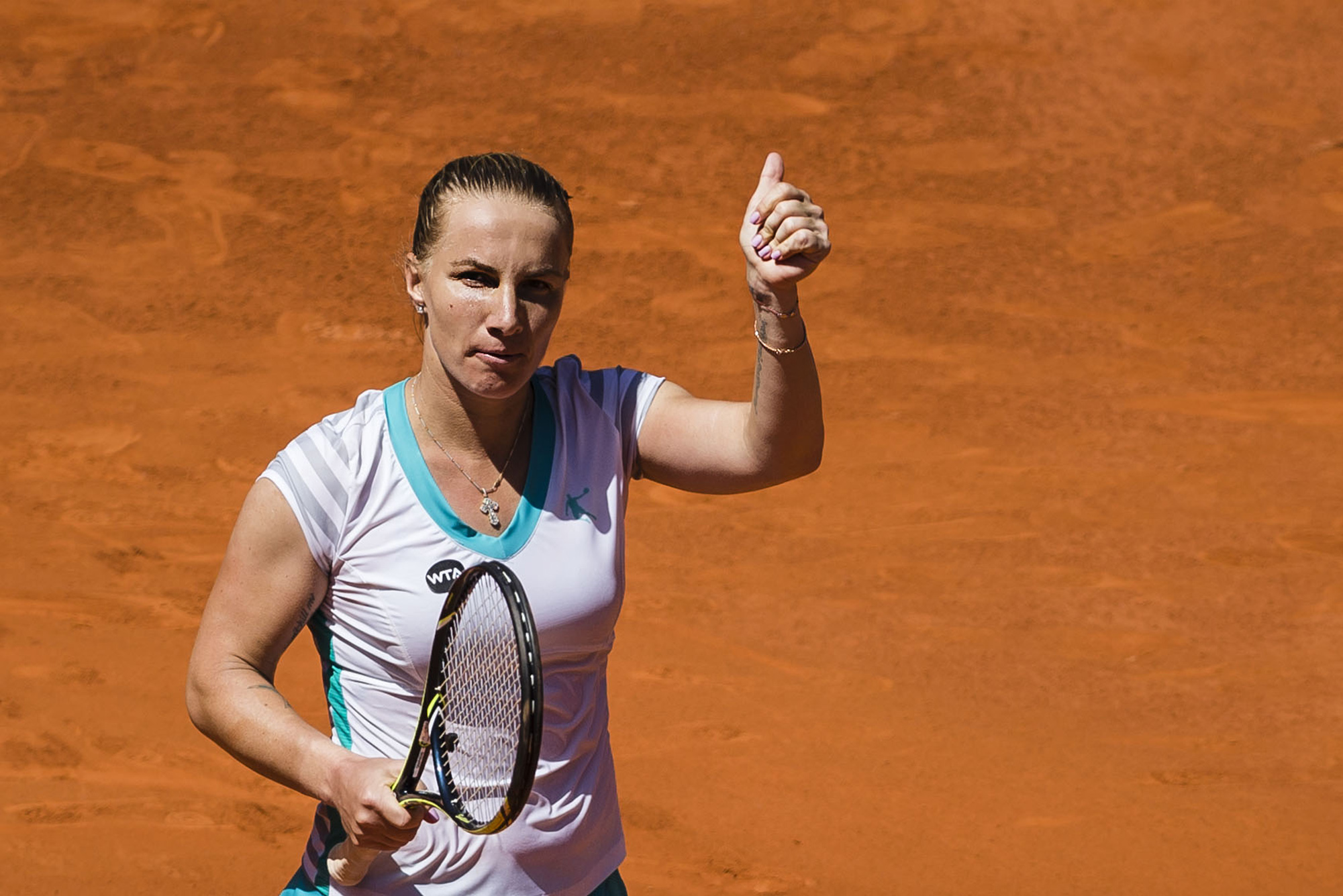 Svetlana Kuznetsova from Russia celebrates after defeating Maria Sharapova from Russia after their Madrid Open tennis tournament match in Madrid, Spain, Friday, May 8, 2015. (AP Photo/Daniel Ochoa de Olza)