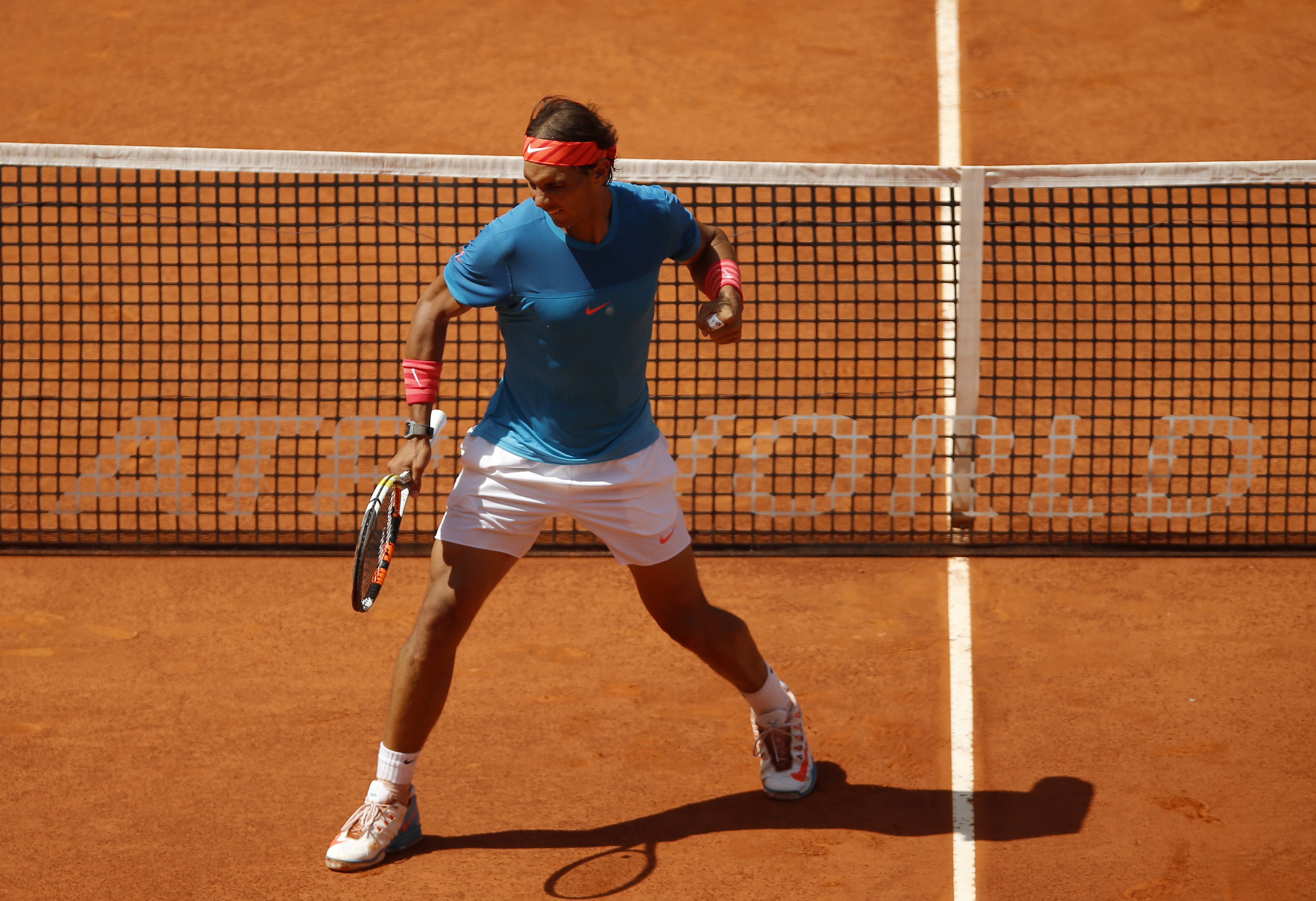 Rafael Nadal of Spain celebrates a point against Tomas Berdych of the Czech Republic  during the semifinal of the Madrid Open Tennis tournament in Madrid, Spain, Saturday, May 9, 2015. (AP Photo/Daniel Ochoa de Olza)