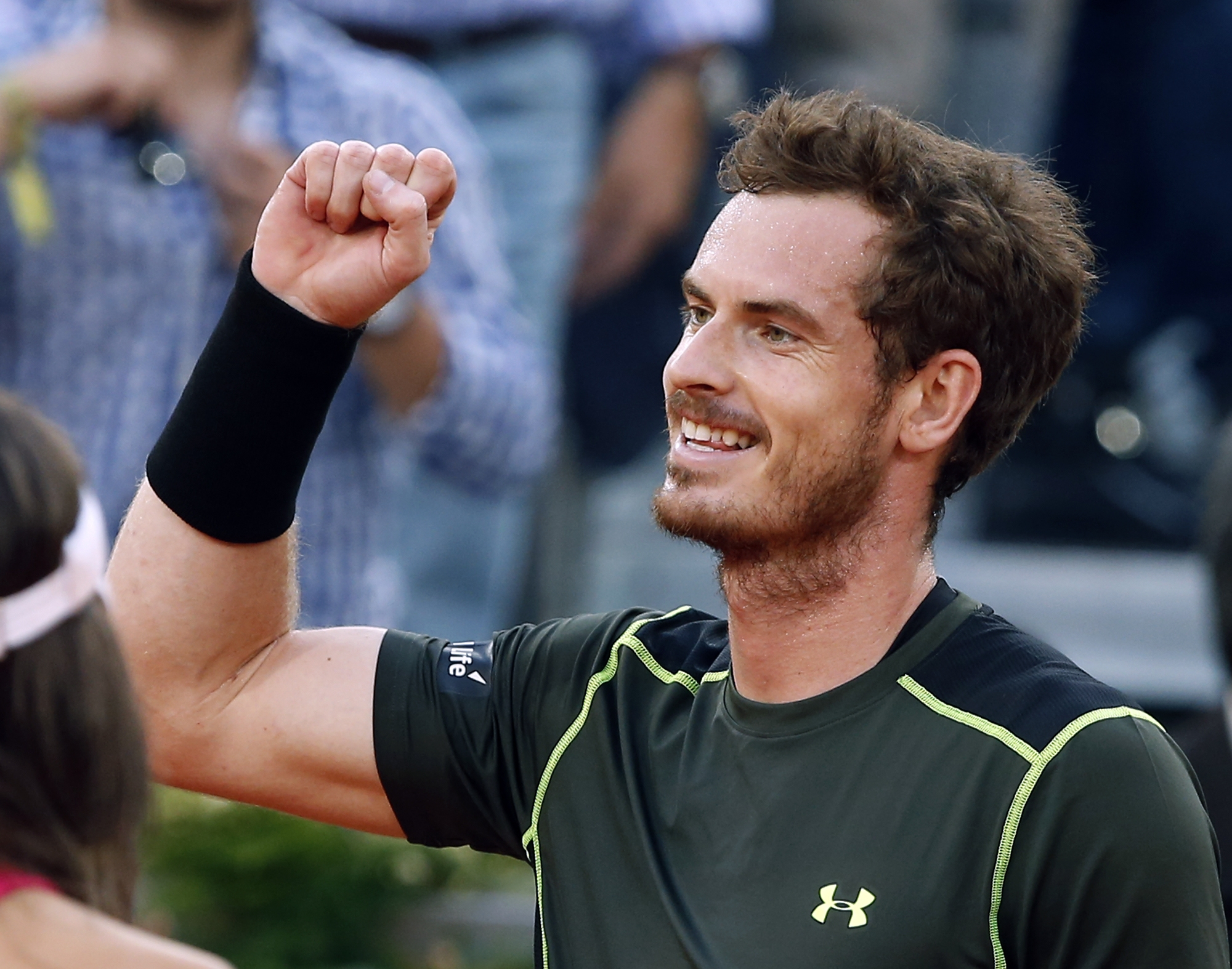 Andy Murray of Britain celebrates after defeating Rafael Nadal of Spain 6-3, 6-2, in their men's singles final match at the Madrid Open Tennis tournament in Madrid, Spain, Sunday, May 10, 2015. (AP Photo/Paul White)