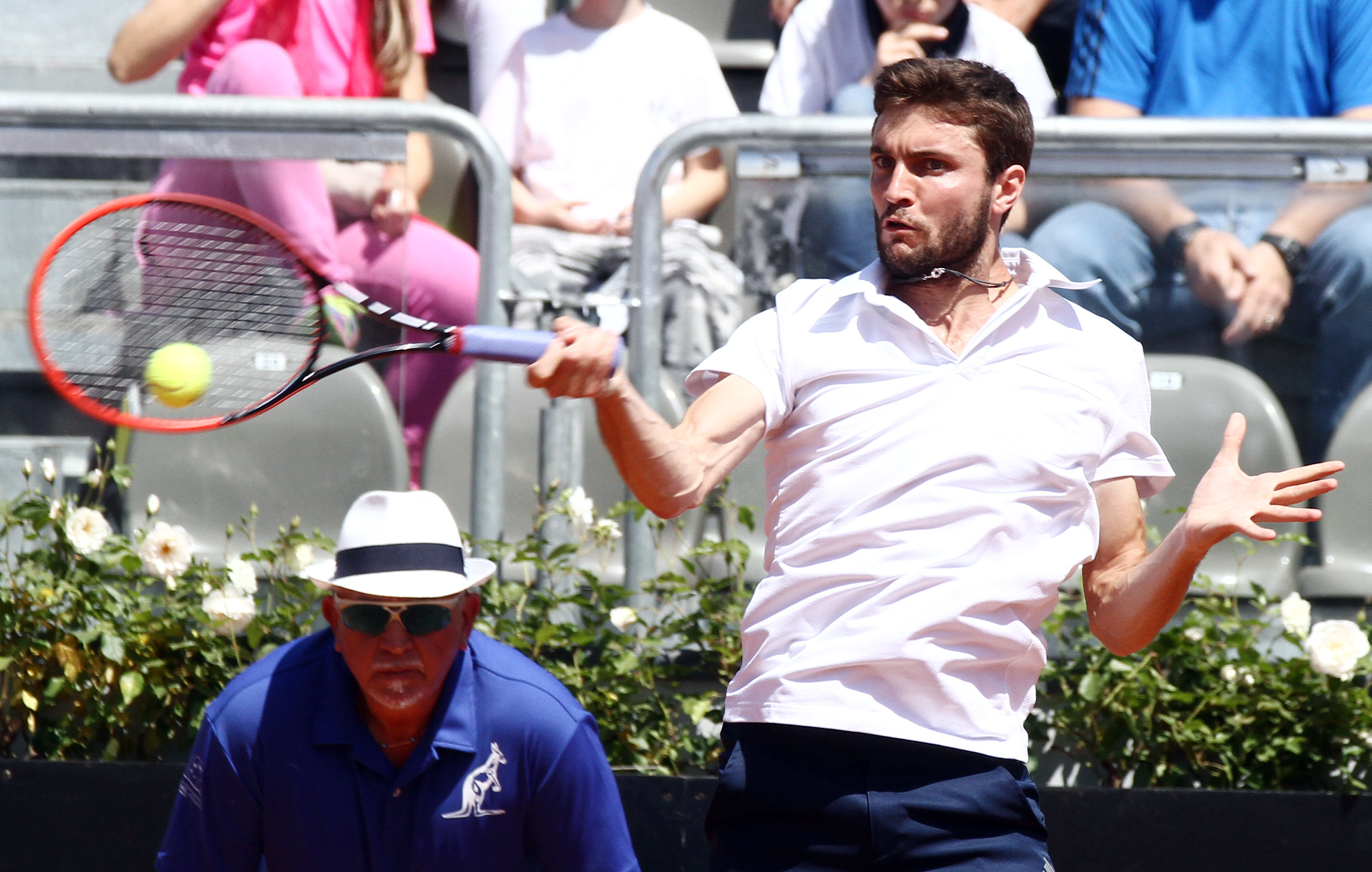 France's Gilles Simon returns the ball to Jack Sock from US during their match at the Italian Open tennis tournament, in Rome, Monday, May 11, 2015. (AP Photo/Felice Calabro')