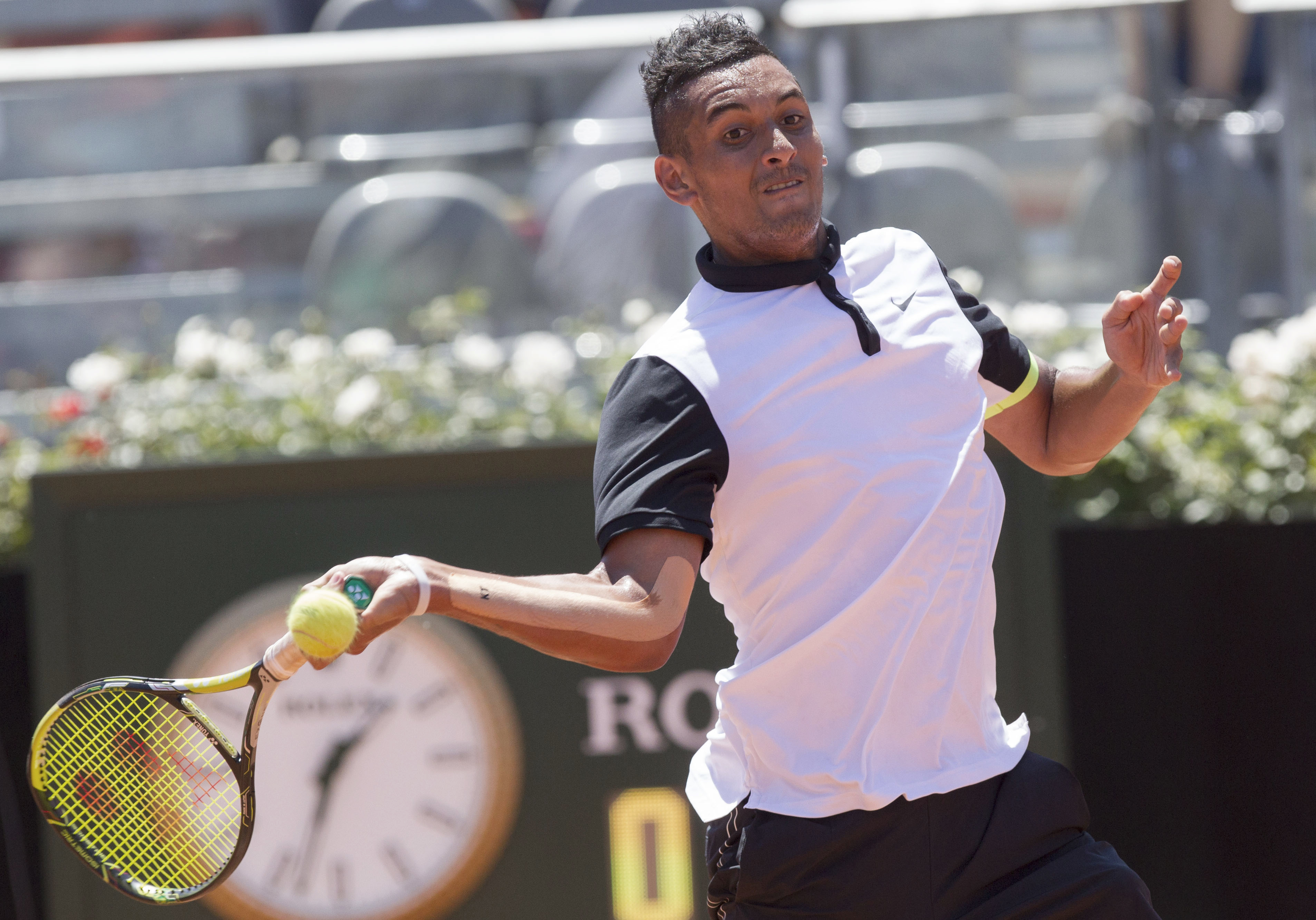Australia's Nick Kyrgios returns the ball to Spain's Feliciano Lopez during their match at the Italian Open tennis tournament, in Rome, Tuesday, May 12, 2015. (AP Photo/Riccardo De Luca)