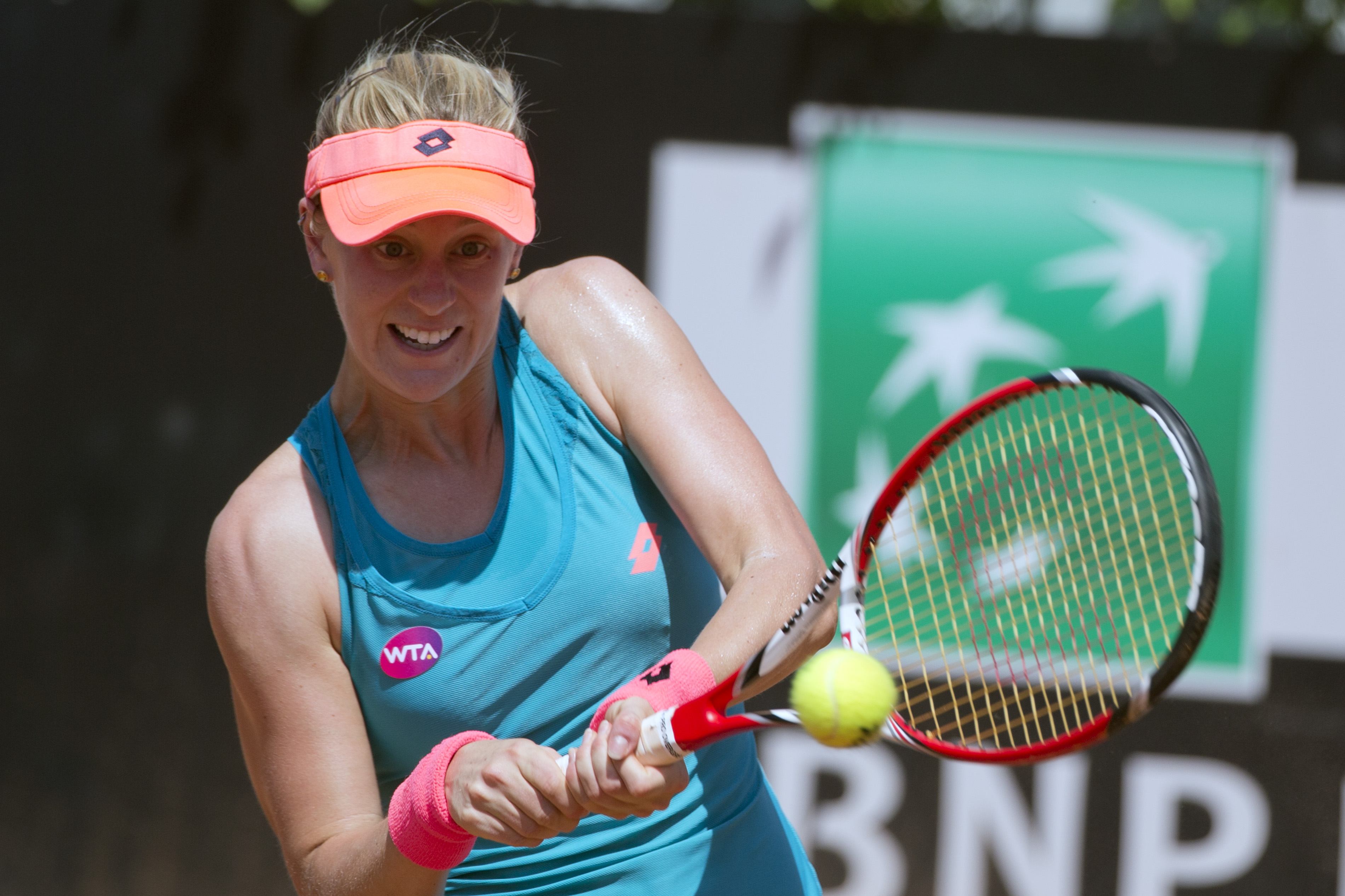 Alison Riske, of the United States, returns the ball to Simona Halep, of Romania, during their match at the Italian Open tennis tournament, in Rome, Wednesday, May 13, 2015. (AP Photo/Andrew Medichini)