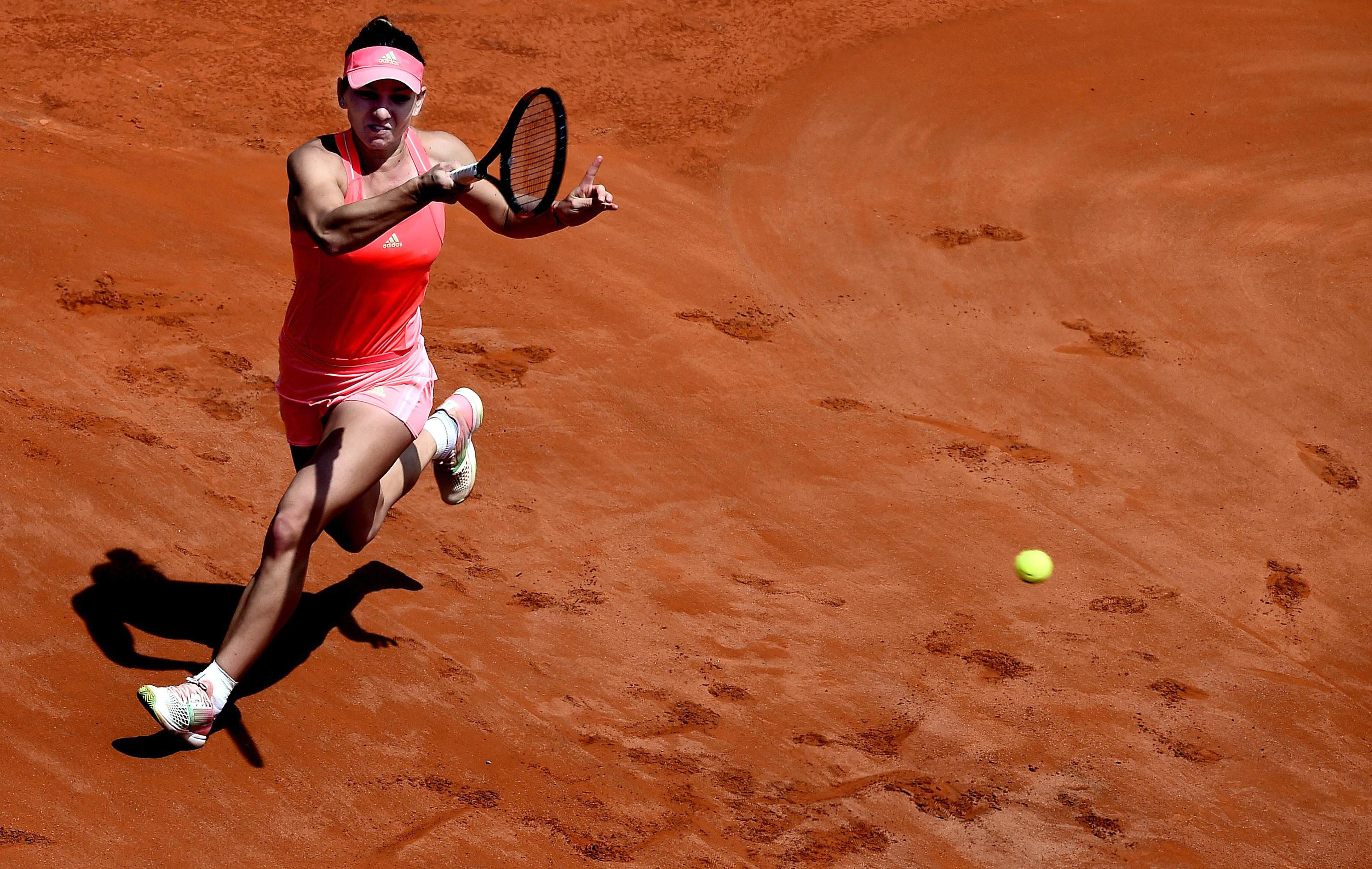 Romania's Simona Halep strikes a forehand to Spain's Carla Suarez Navarro, during their semifinal match at the Italian Open tennis tournament, in Rome, Saturday, May 16, 2015. (Claudio Onorati/ANSA via AP)